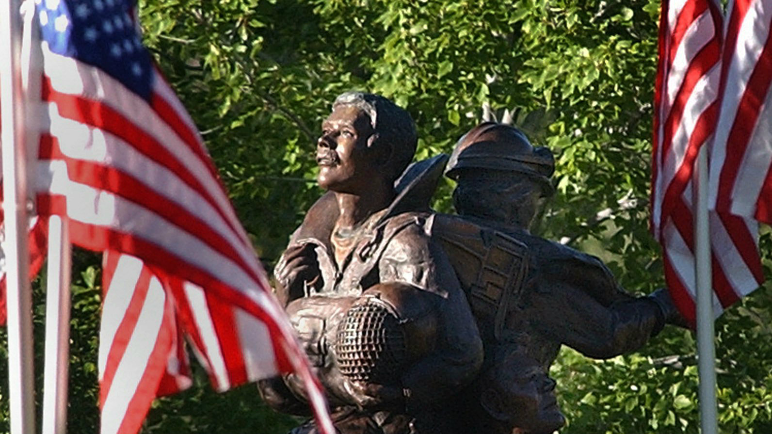 <p>The morning sun highlights a monument in Glenwood Springs, Colo., on Tuesday, July 6, 2004, dedicated to the 14 firefighters who died while fighting a wildfire on nearby Storm King Mountain. </p>