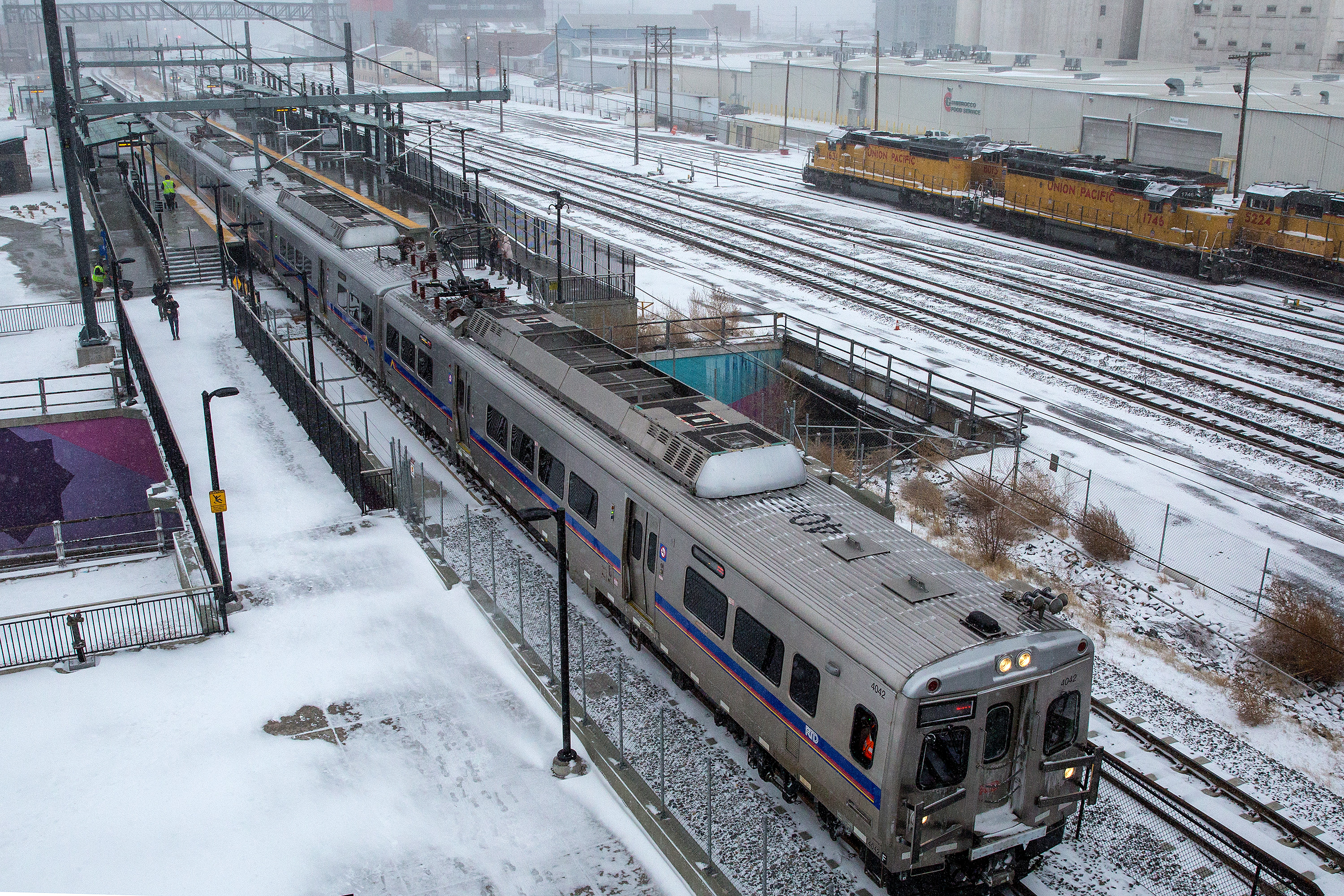 "<p class=""normal"">An RTD A Line commuter rail train at the 38th and Blake Street station in Denver.</p>"