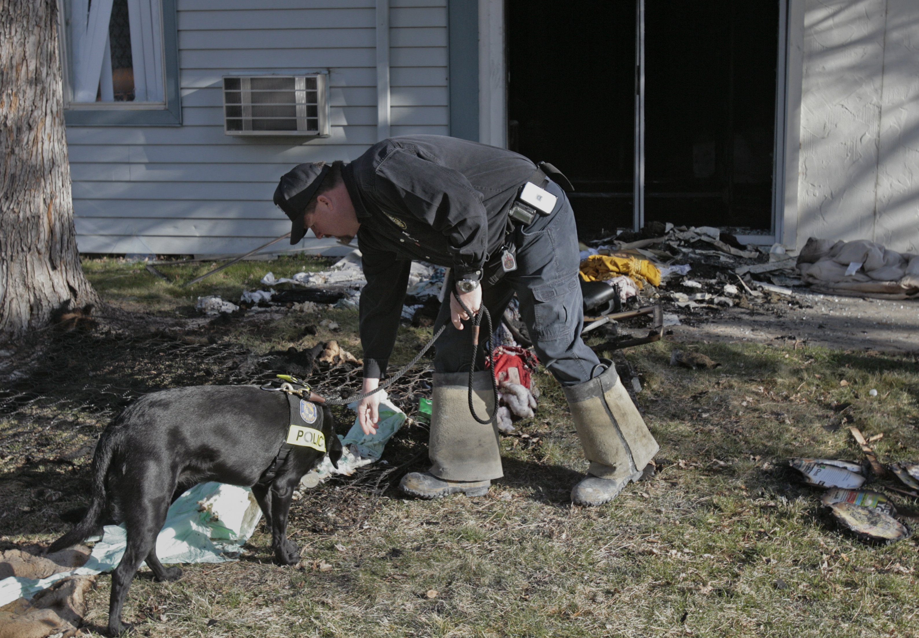 <p>Colorado Bureau of Investigation Agent Jerry Means with an arson dog.</p>