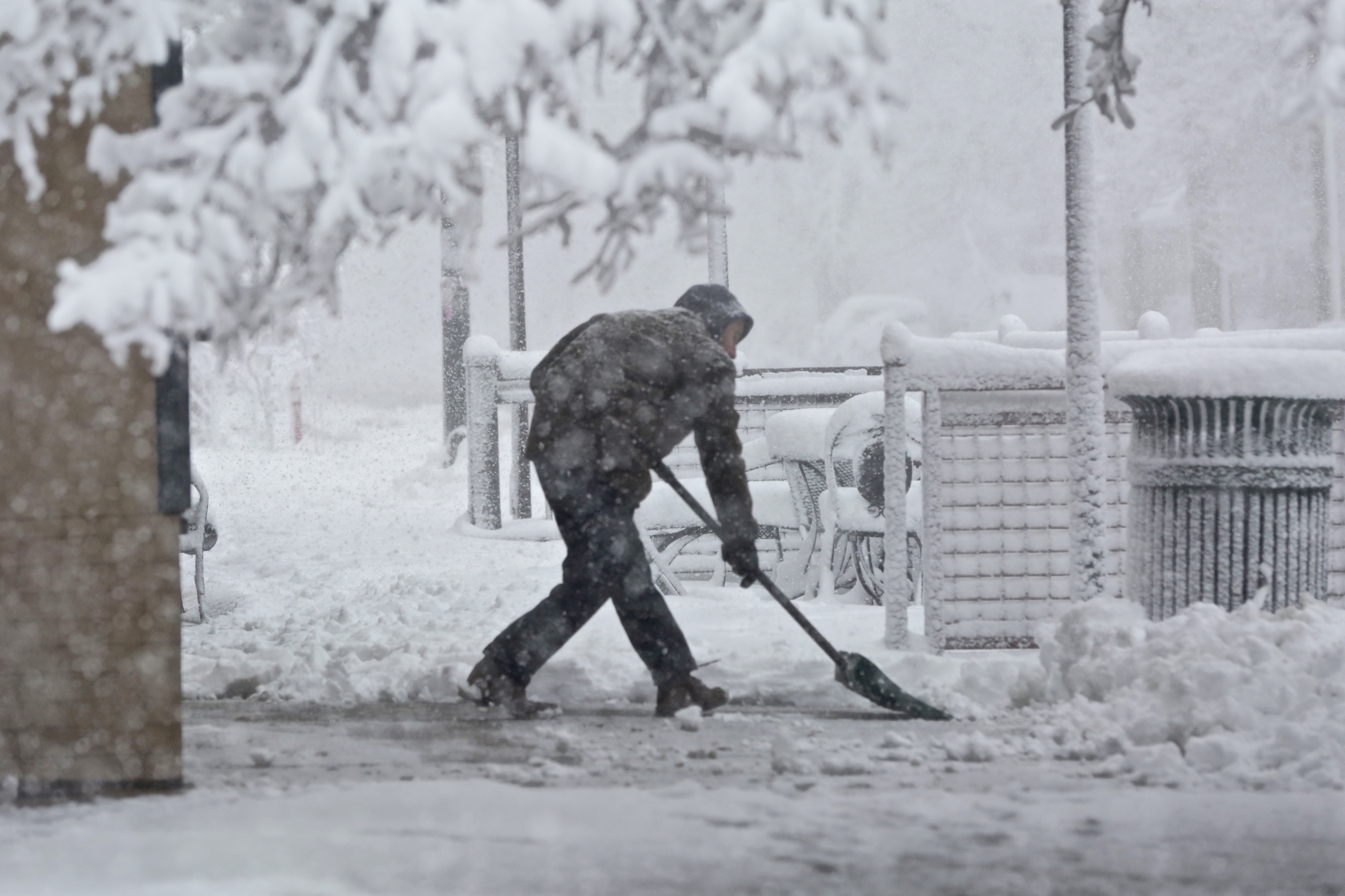 <p>Shoveling snow on 23rd Avenue in Denver on Wednesday, March 23, 2016.</p>