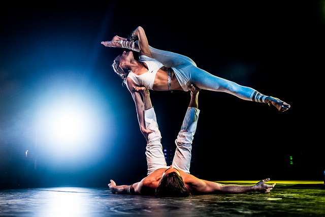 <div>Yoga teachers Matt Giordano (on the bottom) and Chelsey Korus (on the top) perform acro-yoga in front of hundreds of participants at Wanderlust festival 2014 in Snowmass Village, Colo. </div>
