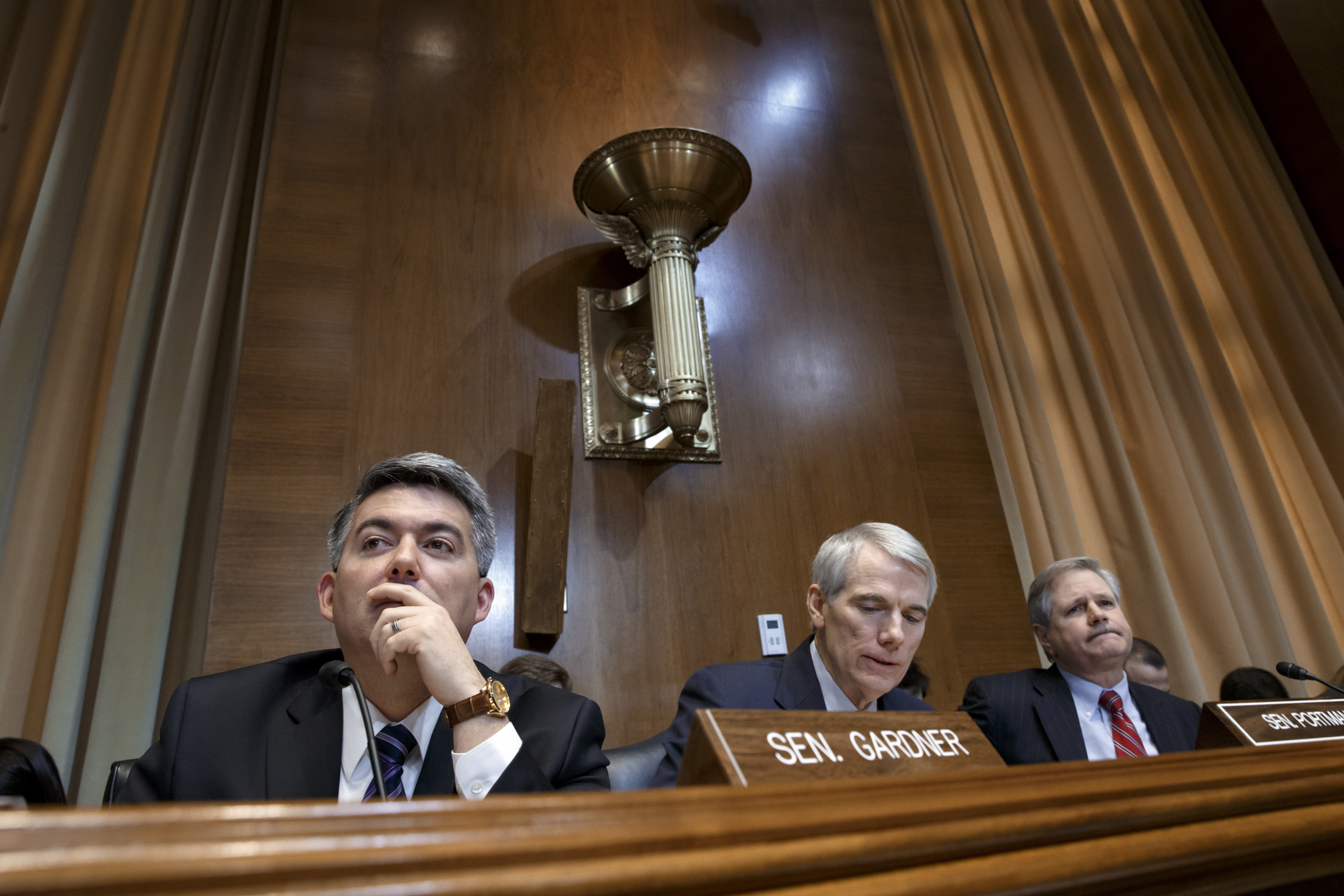 <p>From left, Senate Energy and Natural Resources Committee members Sen. Cory Gardner, R-Colo., Sen. Rob Portman, R-Ohio, and Sen. John Hoeven, R-N.D., listen to statements from members of the committee during the markup of the long-stalled Keystone XL pipeline, Jan. 8, 2015, on Capitol Hill in Washington. </p>