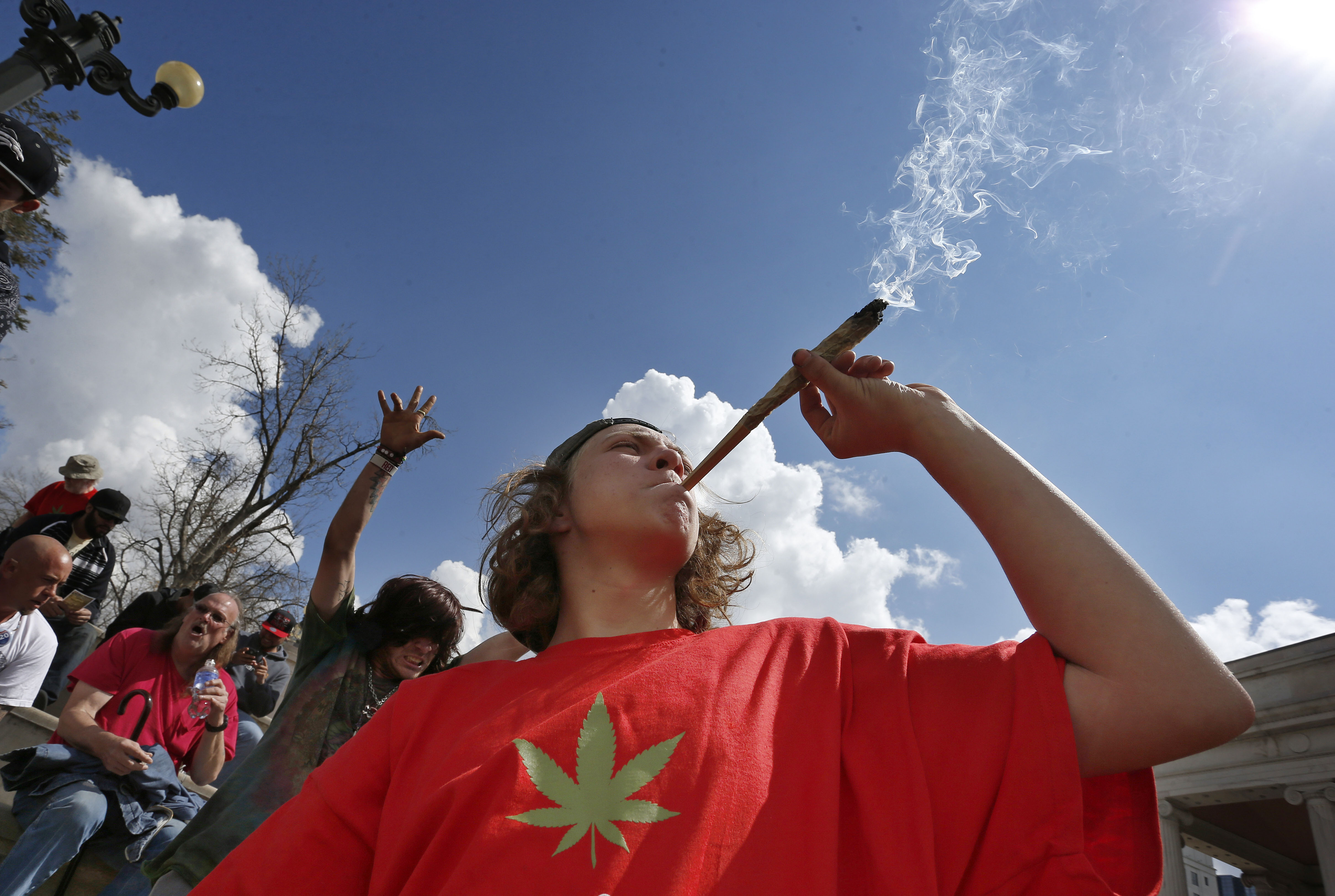 <p>Partygoers listen to music and smoke marijuana on one of several days of the annual 4/20 marijuana festival, in Denver's downtown Civic Center Park, Saturday April 18, 2015.</p>