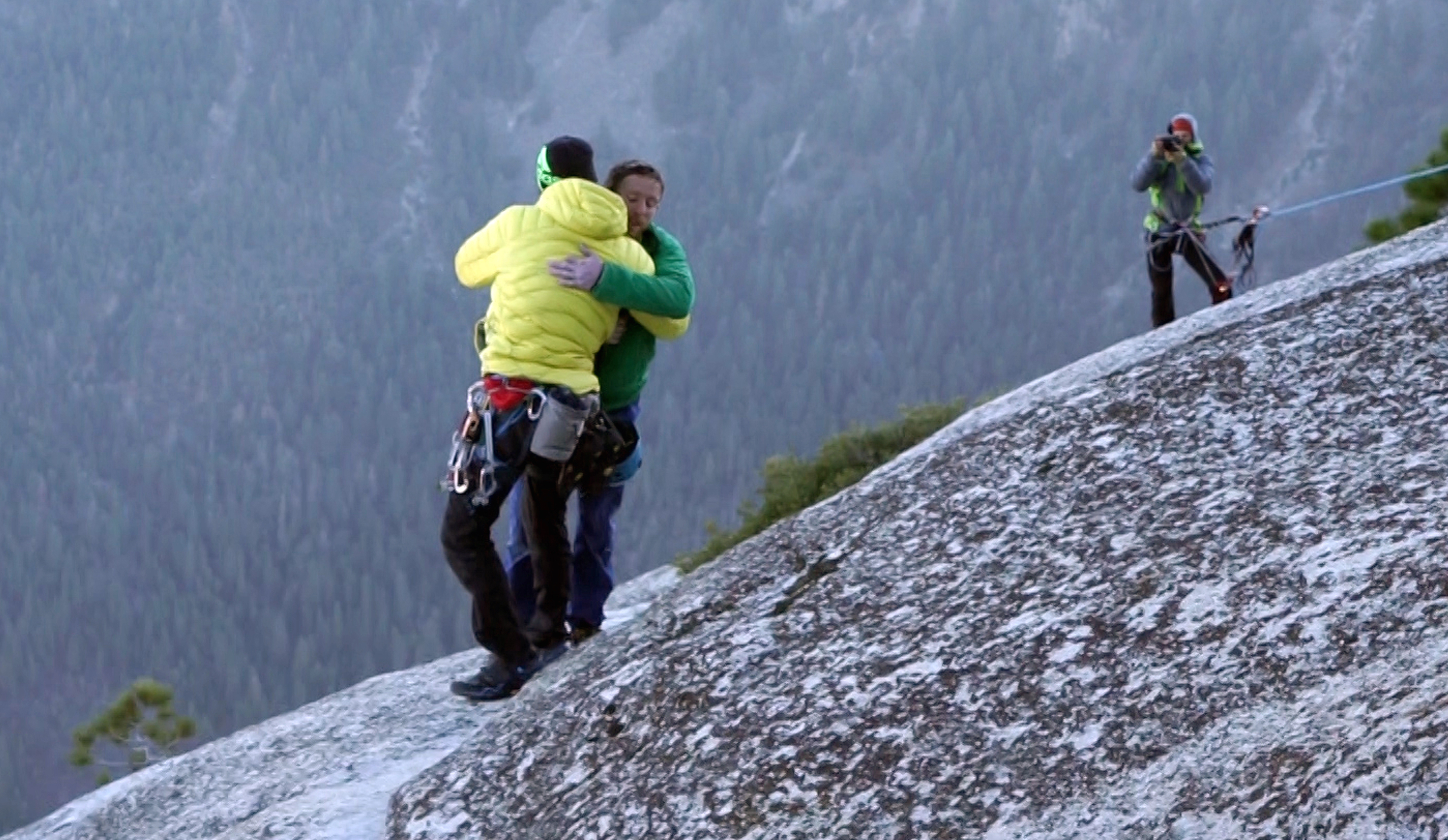 <p>Kevin Jorgeson, left, and Tommy Caldwell embraceeach other after reaching the top of El Capitan, a 3,000-foot sheer granite face in Yosemite National Park, Calif.</p>