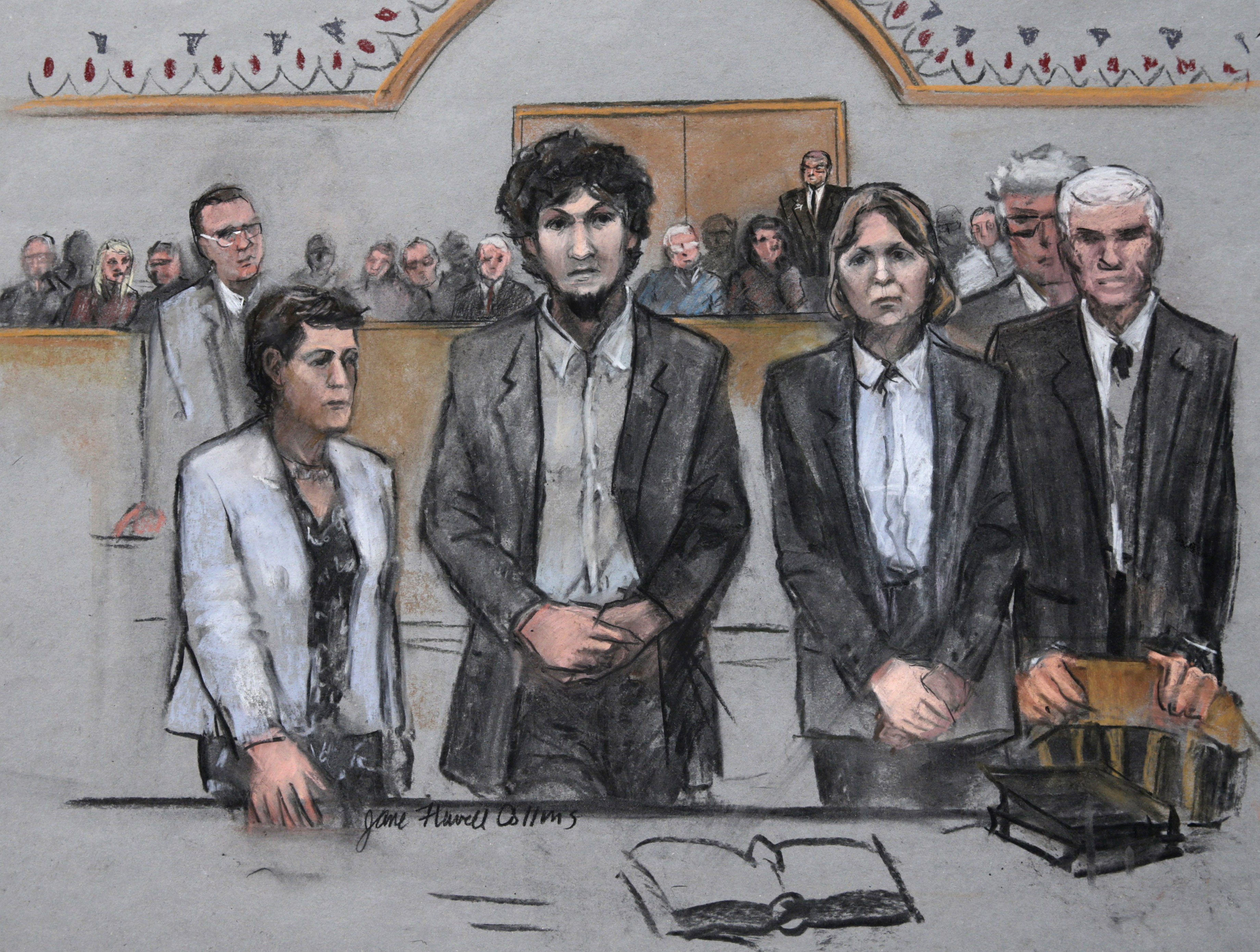 <p>In this courtroom sketch, Boston Marathon bomber Dzhokhar Tsarnaev, center, stands with his defense attorneys as a death by lethal injection sentence is read in the penalty phase of his trial in BostonMay 15, 2015.</p>