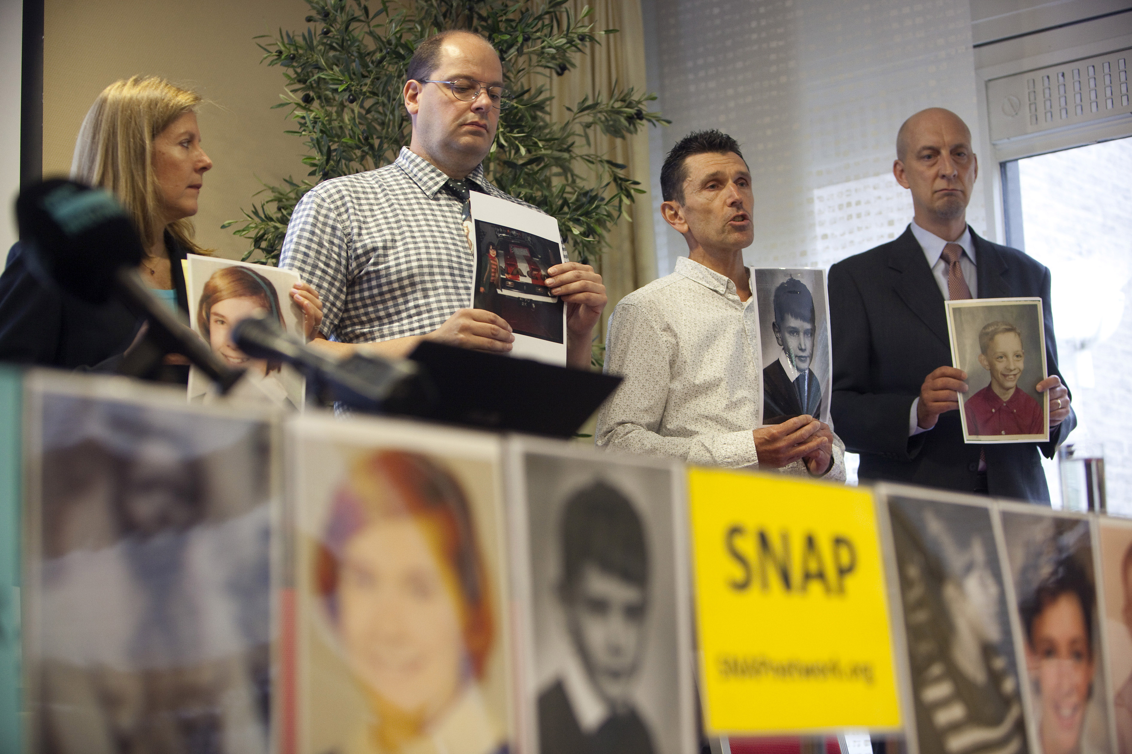 Members of Survivors Network of those Abused by Priests (SNAP)attend a press conference in Voorburg, near The Hague, Netherlands, Tuesday, Sept. 13, 2011.