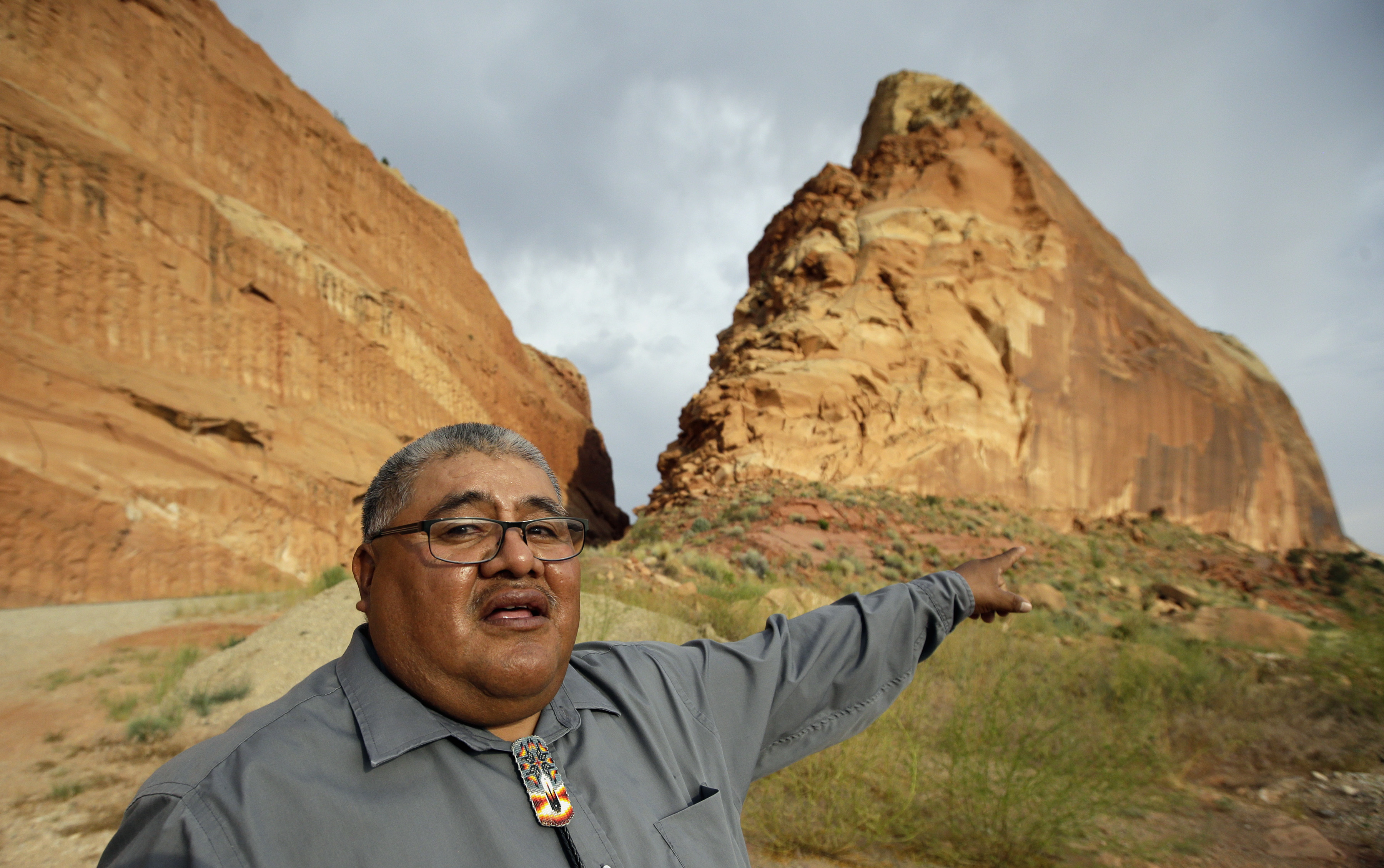 <p>This June 21, 2016, photo, Malcolm Lehi, a Ute Mountain Tribal Commissioner points to a rock formation near Blanding, Utah.</p>