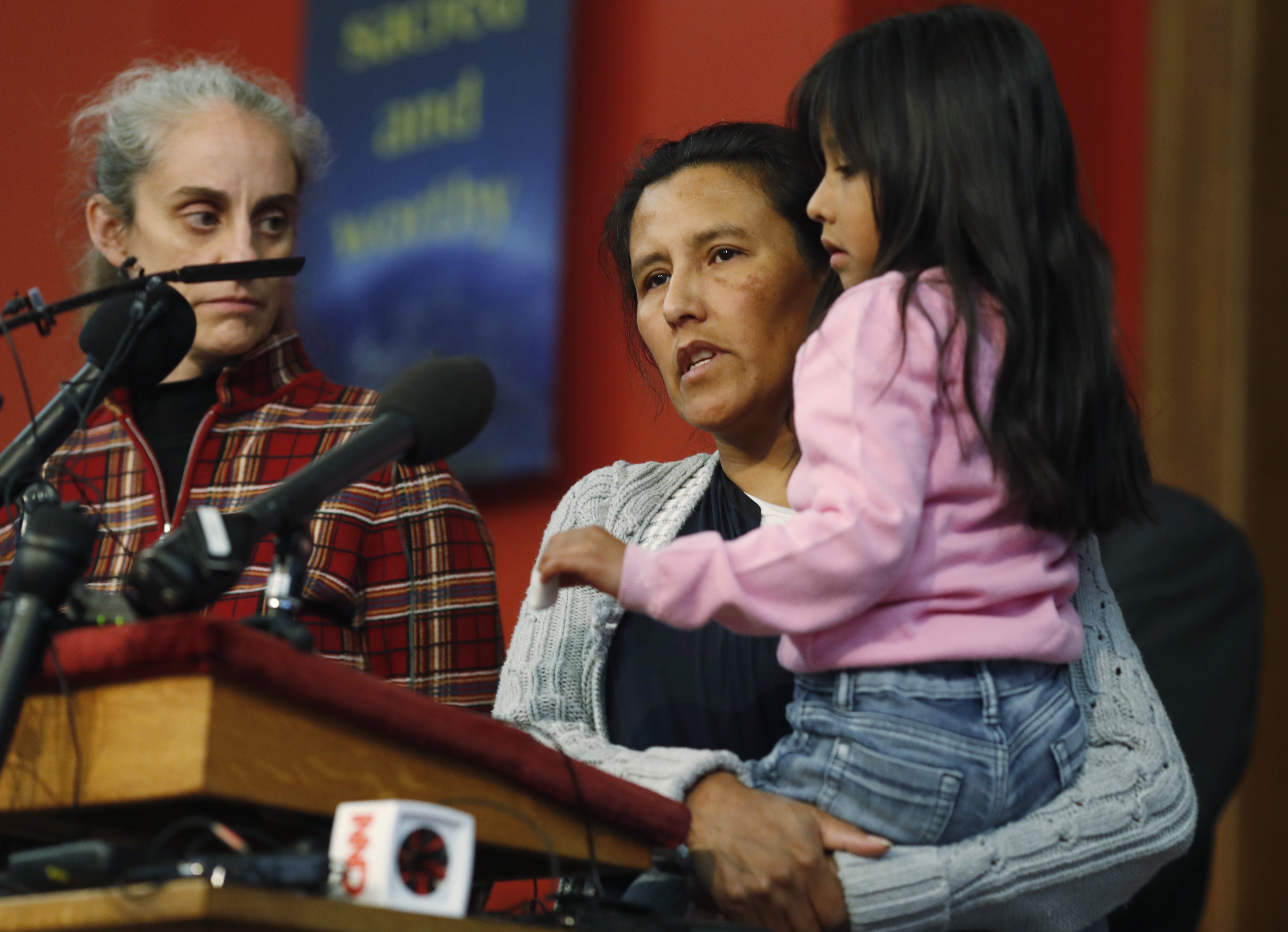 <p>Jeanette Vizguerra, a Mexican woman seeking to avoid deportation from the United States, center, speaks as she holds her 6-year-old daughter, Zuri, right, while Jennifer Piper, left, of the American Friends Service Committee, looks on during a news conference in a church in which Vizguerra and her children have taken refuge, Wednesday, Feb. 15, 2017, in Denver.</p>