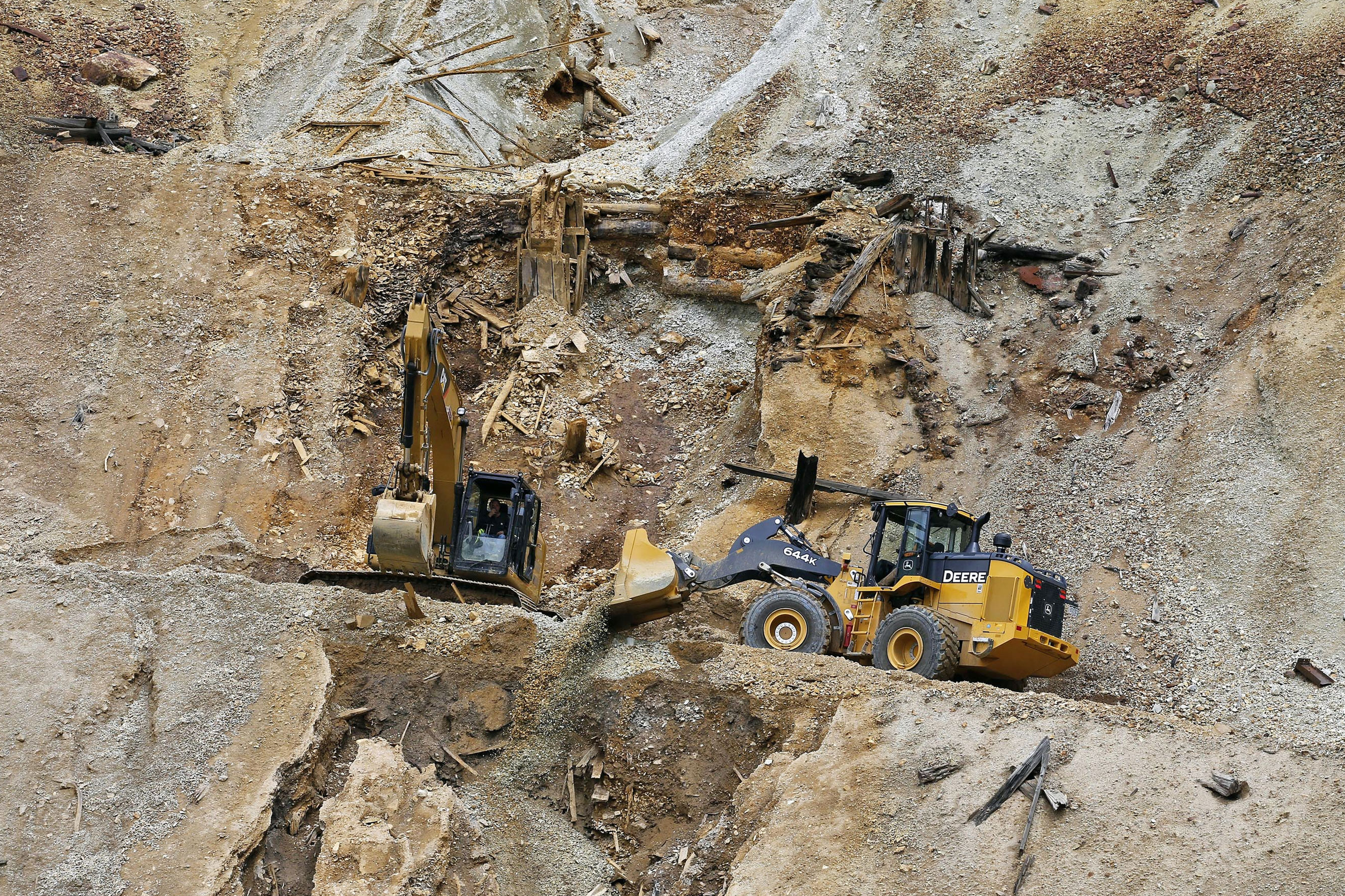 <p>Environmental Protection Agency contractors repair damage at the Gold King mine outside Silverton, Colo., August 2015. The EPA had no rules for working around old mines when the agency inadvertently triggered the massive spill from the Colorado mine that polluted rivers in three states, government investigators said Monday, June 12, 2017.</p>