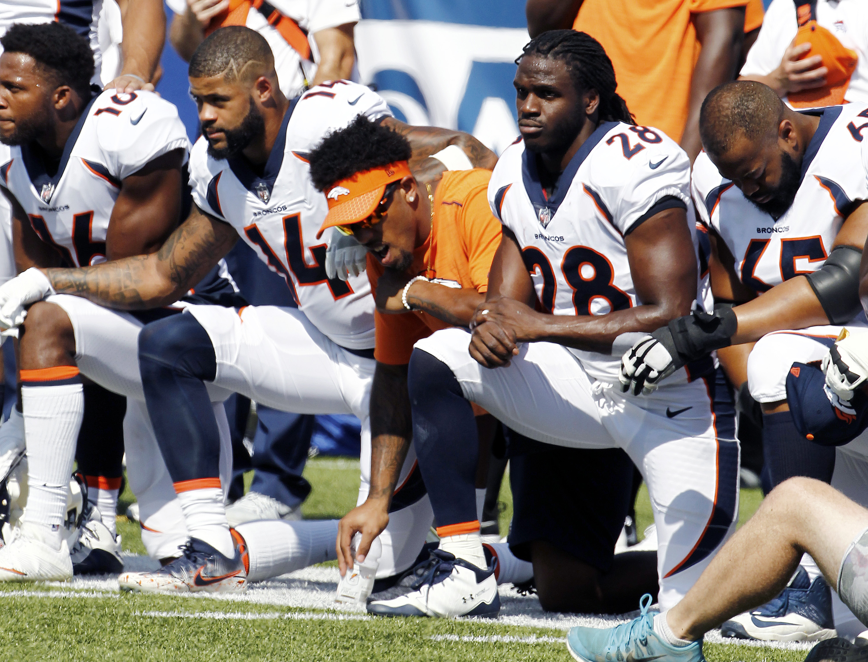 <p>Denver Broncos players kneel during the national anthem prior to their game against the Buffalo Bills, Sunday, Sept. 24, 2017, in Orchard Park, N.Y.</p>