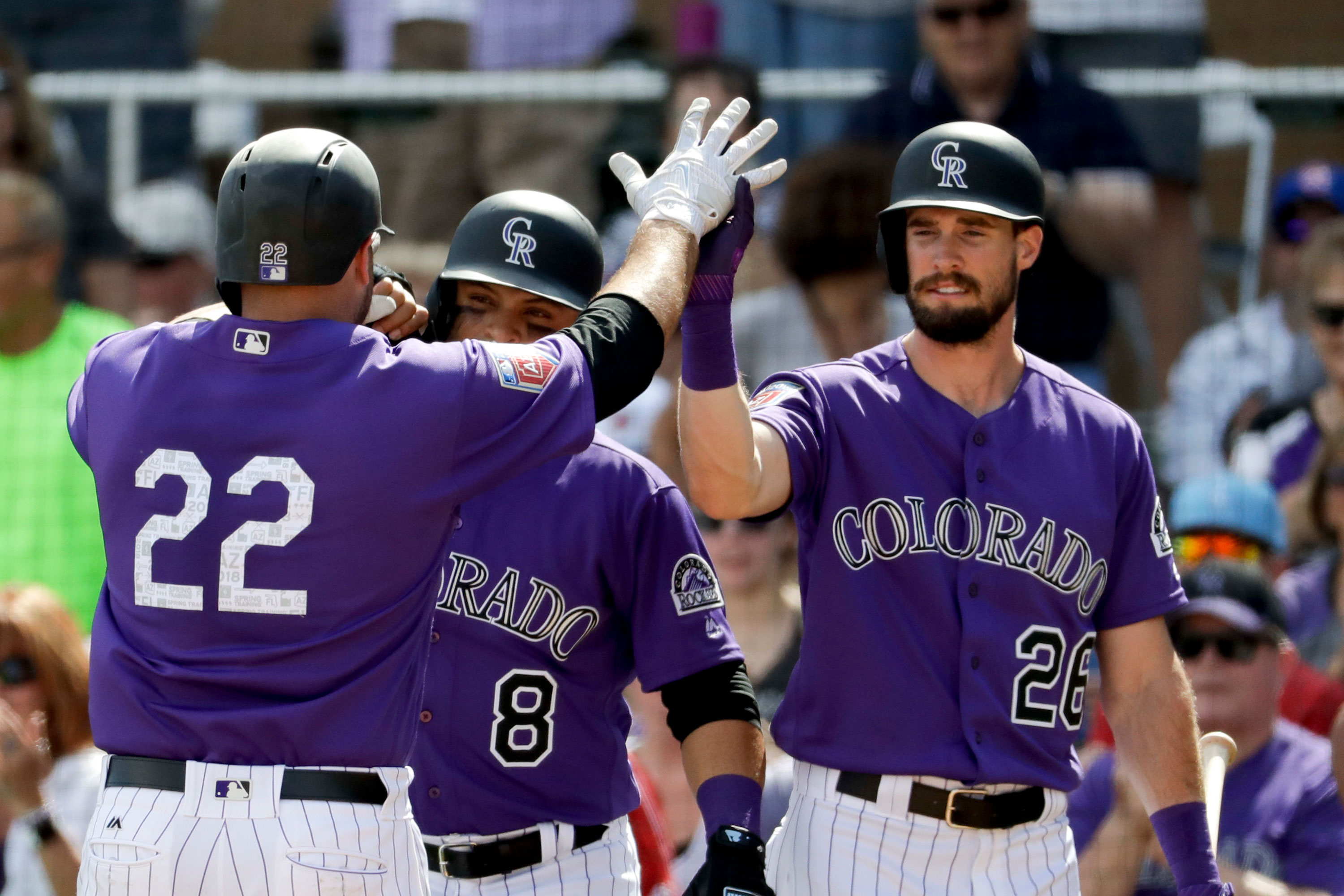 <p>Colorado Rockies' Chris Iannetta, left, celebrates after his two-run home run with David Dahl, right, and Gerardo Parra during the second inning of a spring baseball game against the Los Angeles Dodgers in Scottsdale, Ariz., March 11, 2018.</p>