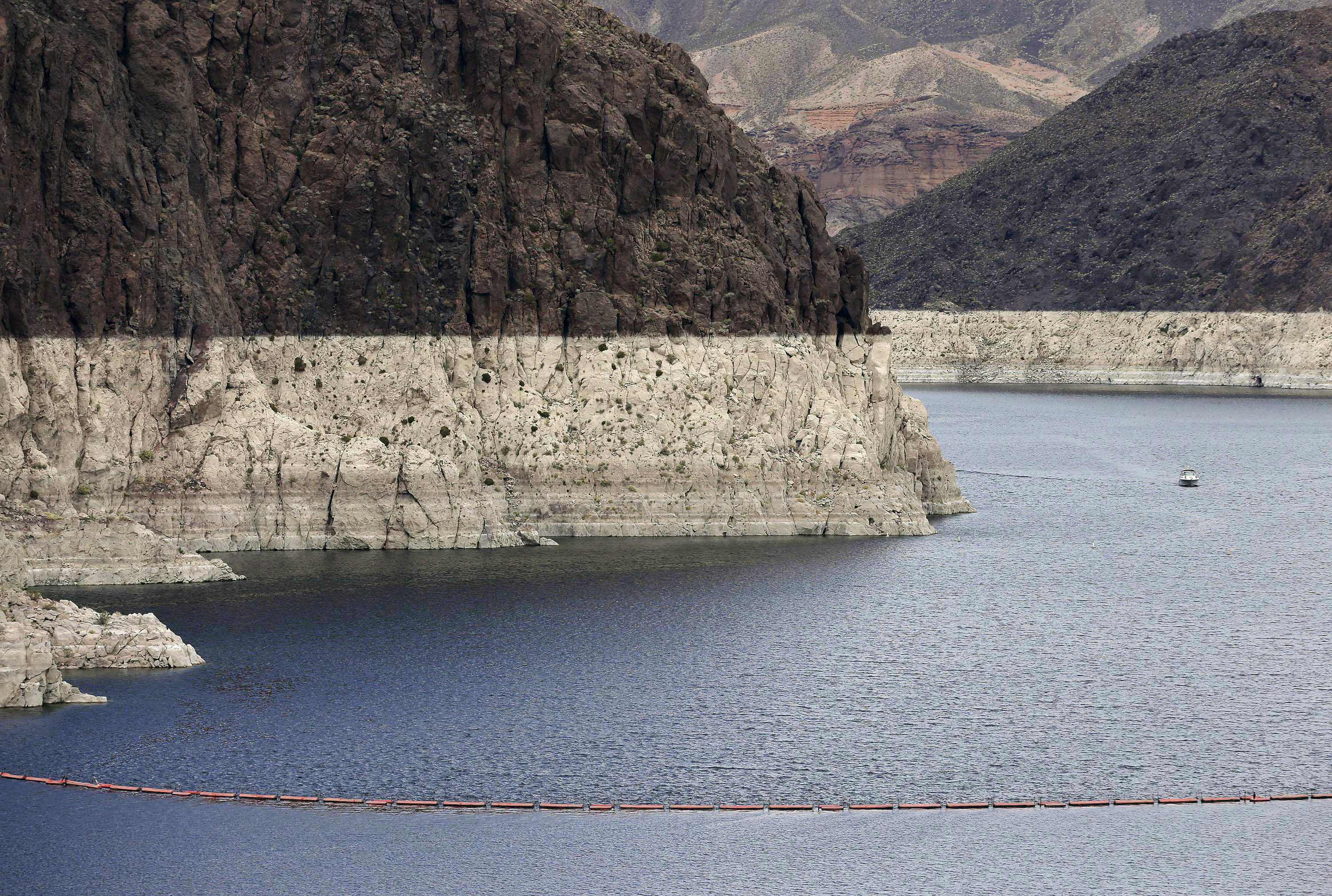 "<p>In this April 16, 2013, file photo, a ""bathtub ring"" shows the high water mark on Lake Mead near Boulder City, Nev.</p>