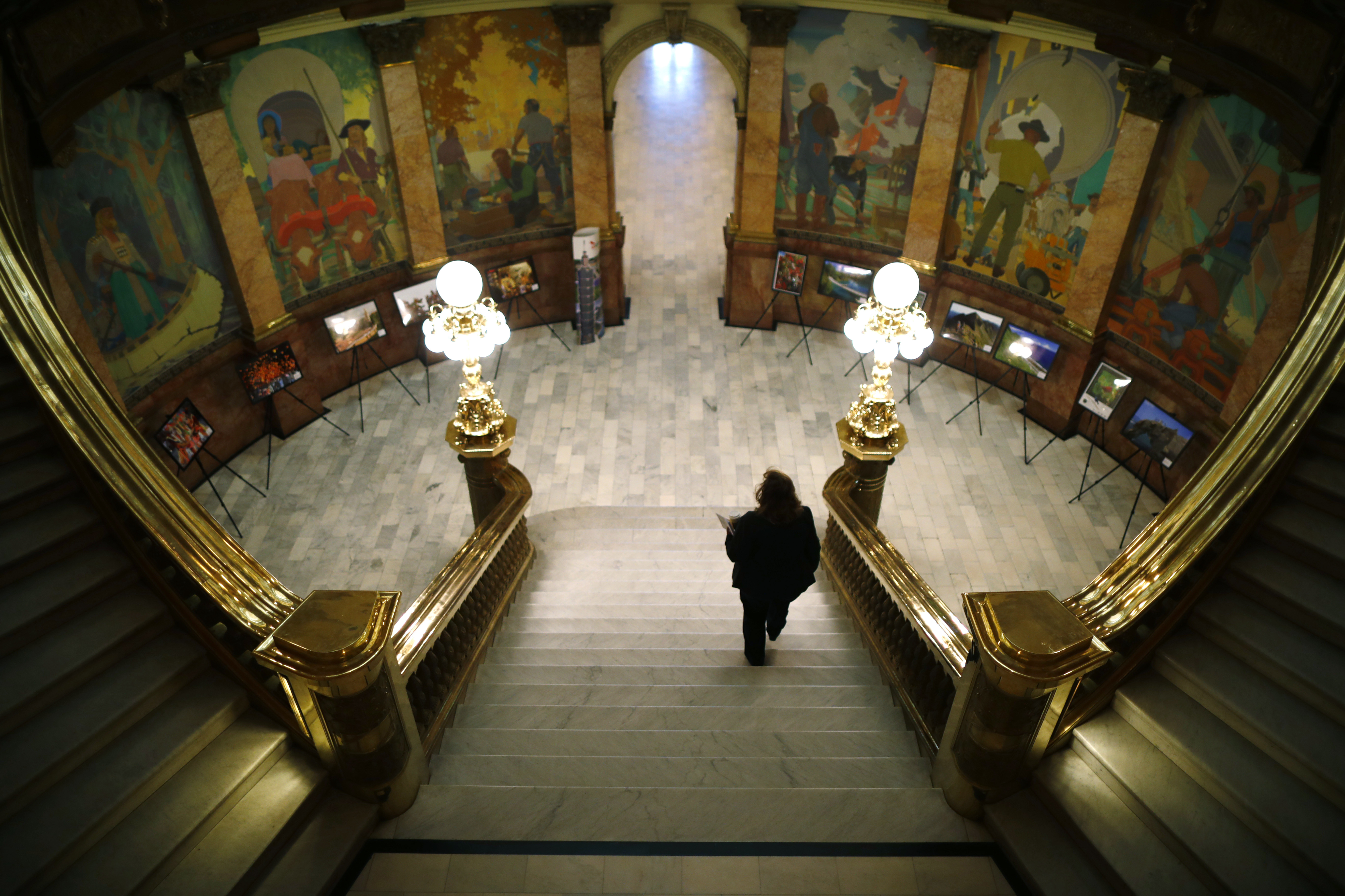 <p>A woman walks down the stairs in the rotunda of the Colorado State Capitol as lawmakers work on the final day of the session Wednesday, May 9, 2018.</p>