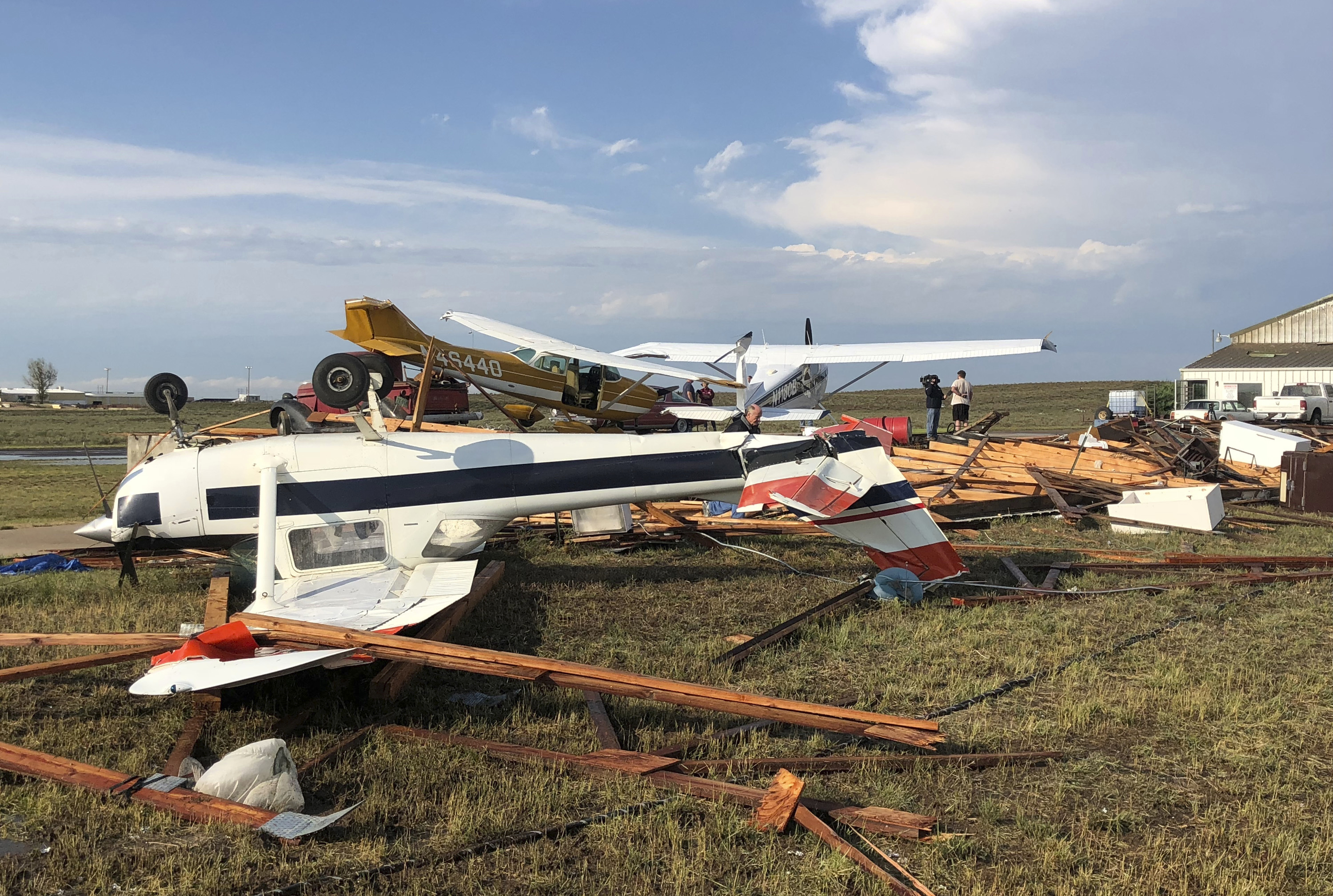 <p>This Sunday, July 29, 2018, photo provided by Colorado Sen. Cory Gardner shows damage from a storm just after it hit the area near Brush, Colo. People on the plains of northeastern Colorado were cleaning up Monday from a powerful storm that swept through the state, ripping off roofs, flipping trucks and damaging crops. No serious injuries were reported. </p>