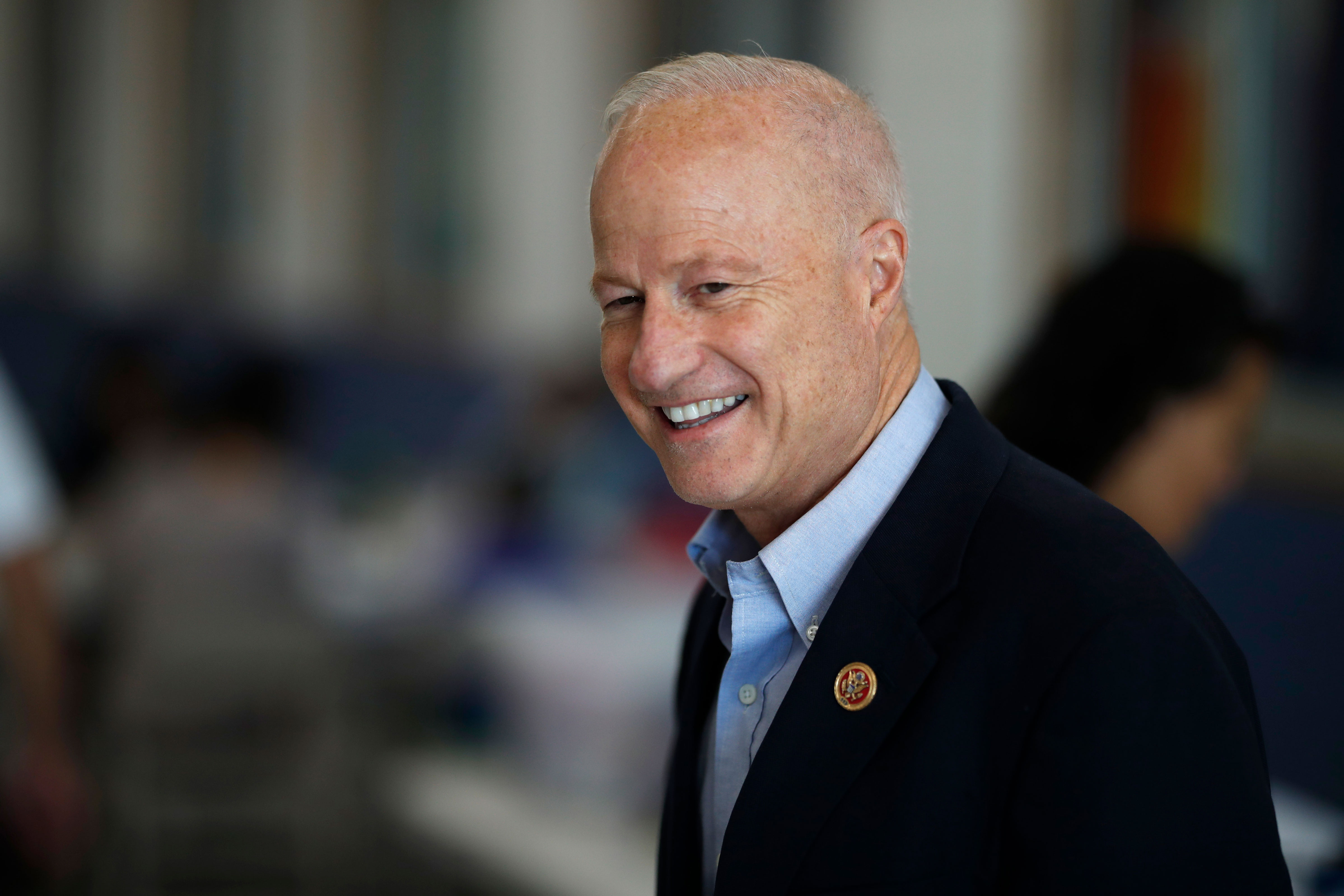 <p>U.S. Rep. Mike Coffman, R-Colo., who represents Congressional District 6, greets voters at the Great Wall Chinese Academy, a school that teaches Mandarin language and Chinese culture Sunday, Oct. 21, 2018.</p>