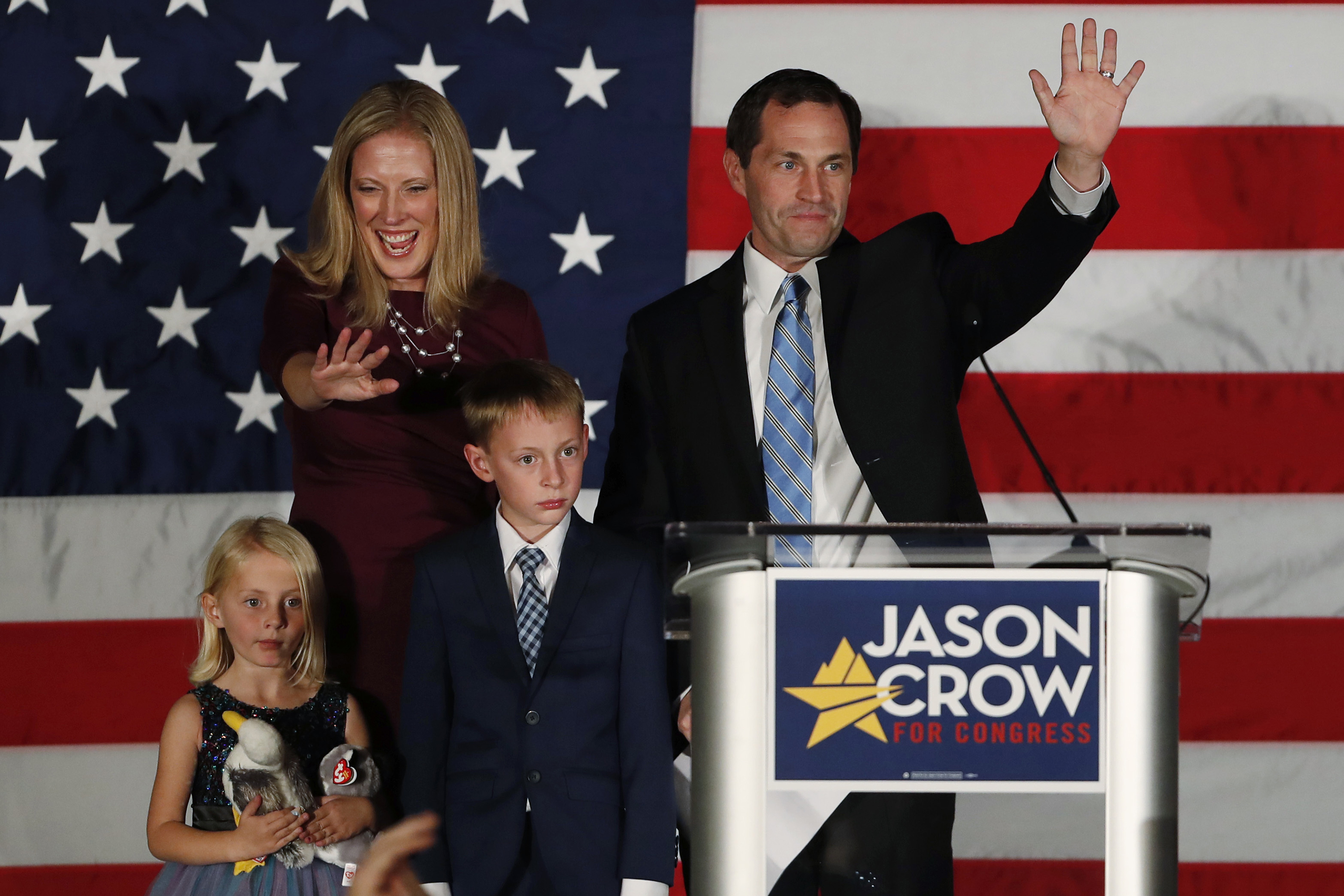 <p>Jason Crow, his wife Deserai, back left, and their 5-year-old daughter Josephine, front right, and 8-year-old son Anderson in greetsupporters Tuesday, Nov. 6, 2018, during an election night watch party in Greenwood Village, Colo. Crow defeated Republican incumbent Mike Coffman to win 6thCongressional District seat.</p>