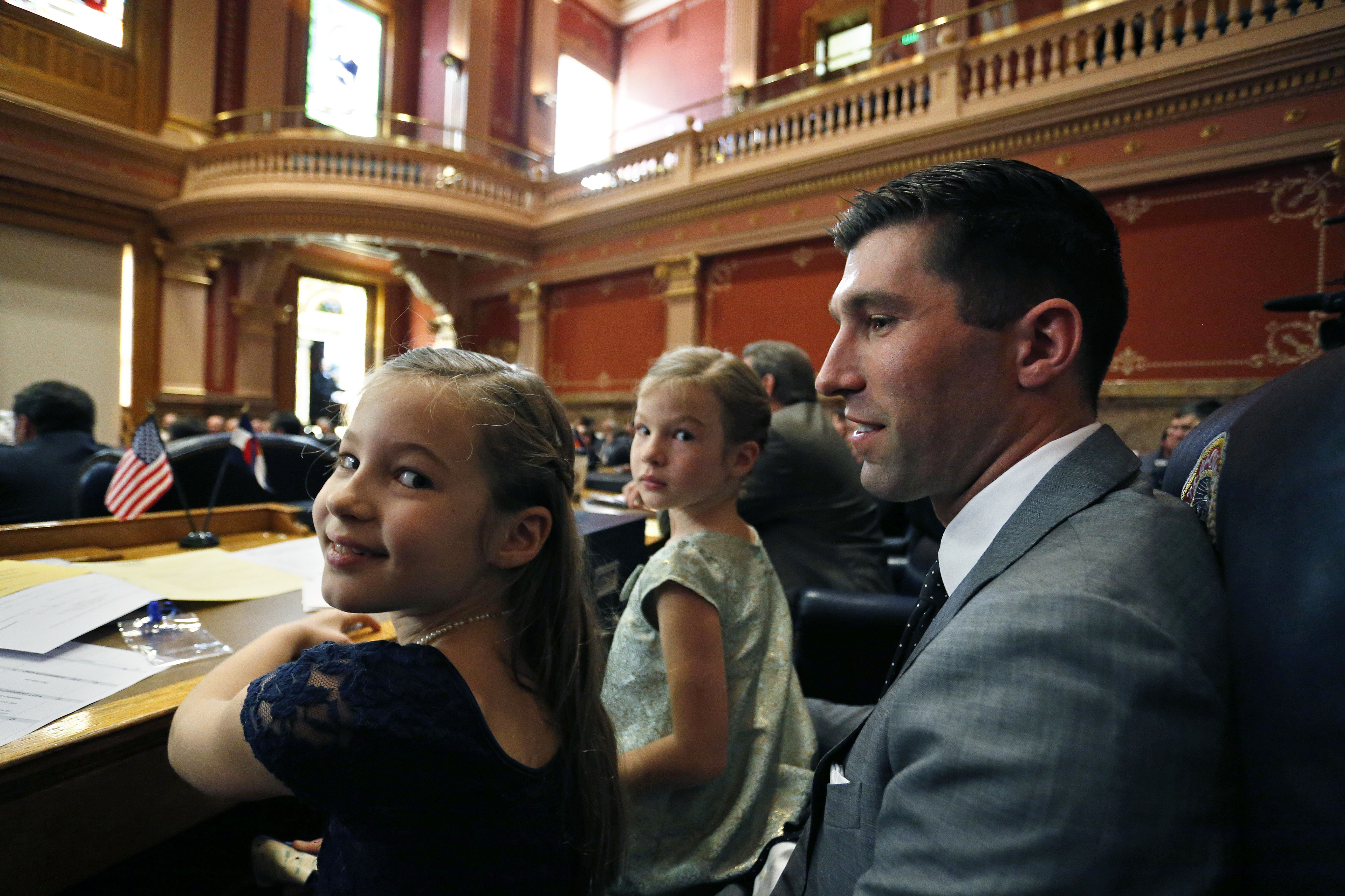 <p>Colorado Republican State Sen. Owen Hill sits with his daughters Miette, left, and Ellis on the opening day of the 2016 Colorado Legislature, at the Capitol, in Denver, Wednesday Jan. 13, 2016.</p>