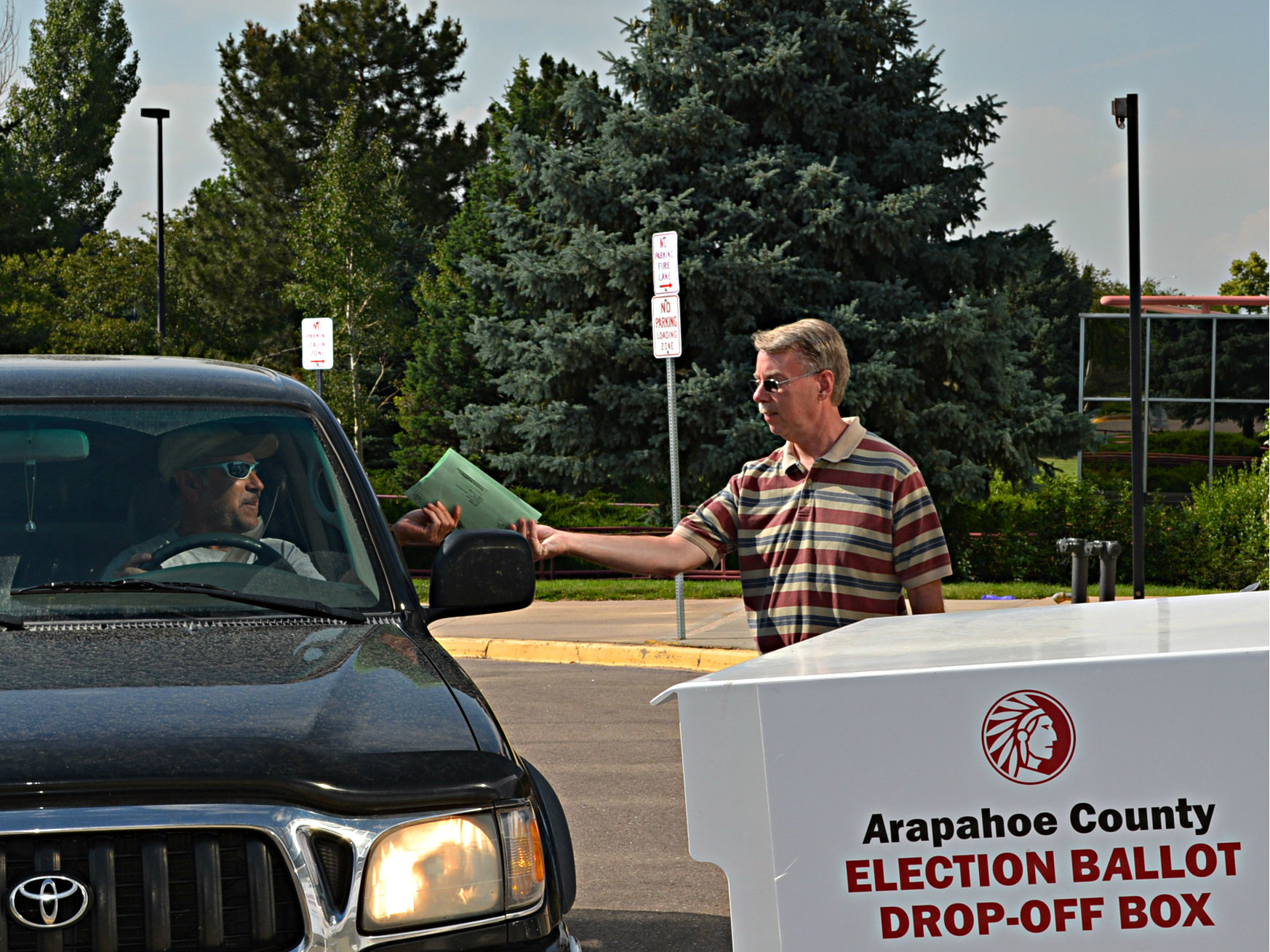 <p>A voter drops off their ballot in Arapahoe County. Colorado is moving toward a new 'risk-limiting' audit system, intended to ensure officials catch any equipment problems large enough to affect election results.</p>