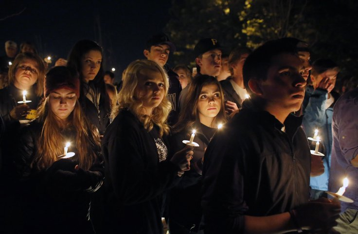 <p>Arapahoe High School students and supporters hold a candlelight vigil during a one-year remembrance ceremony on Clarity Commons, named for student Claire Davis, who was killed in a school shooting one year arlier at Arapahoe High School in Littleton, Colo., Saturday, Dec. 13, 2014.</p>