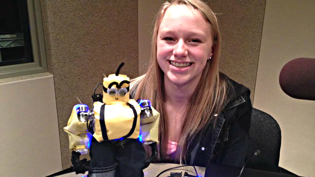 <p>Audrey Menzer, 14, with one of the robots she's submitting in the International Robot Olympiad in Denver. It's built to look like a minion from the animated film Despicable Me.</p>