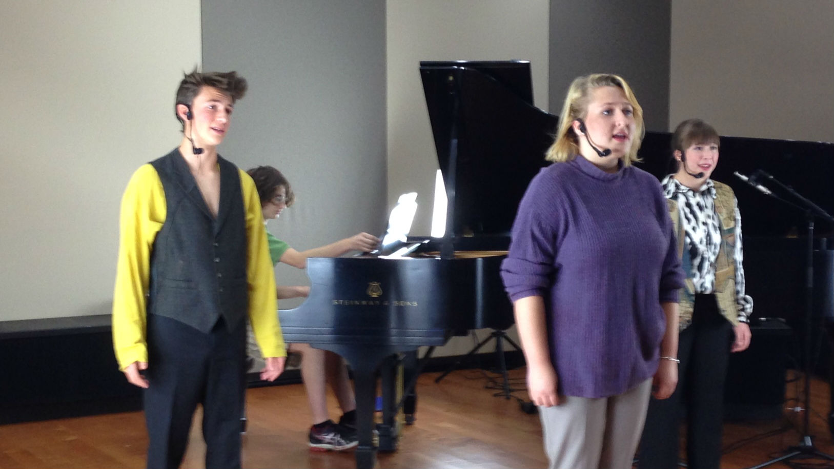 "<p>Left to right: Solomon Abell, Elise Falkenstein and Mikayla Aiken perform the song ""Trio"" from ""Balloon Boy: The Musical"" in the CPR Performance Studio. The show's music director, Oliver Ullman, is on the piano.</p>"