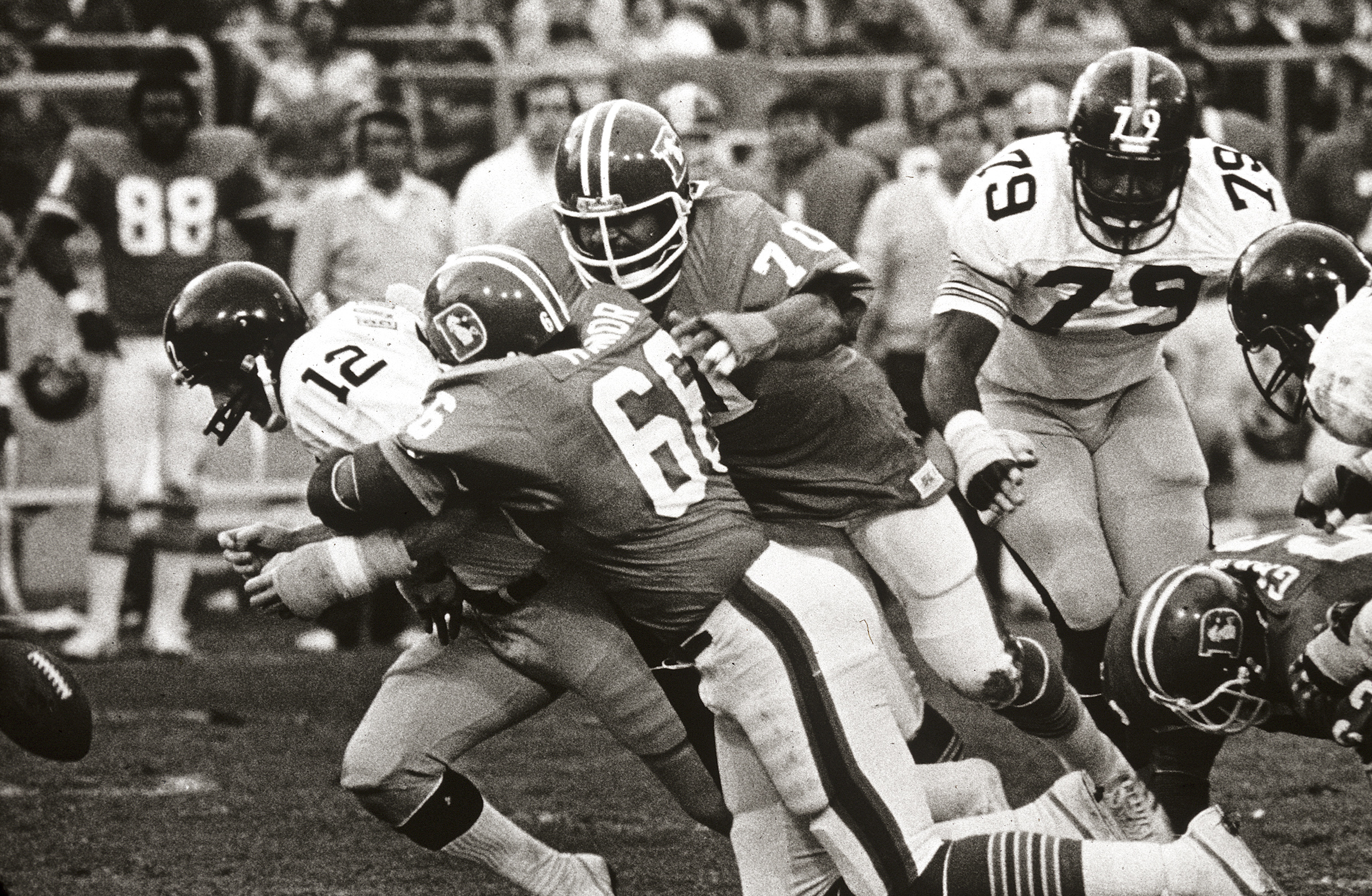 <p>Steelers quarterbackTerry Bradshawis sacked by Denver's defense during the 1977 season.</p>