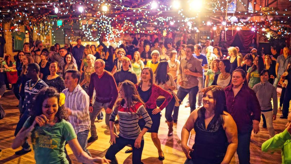 <p>Festival goers take a dance lesson at the 2013 Colorado Brazil Fest</p>