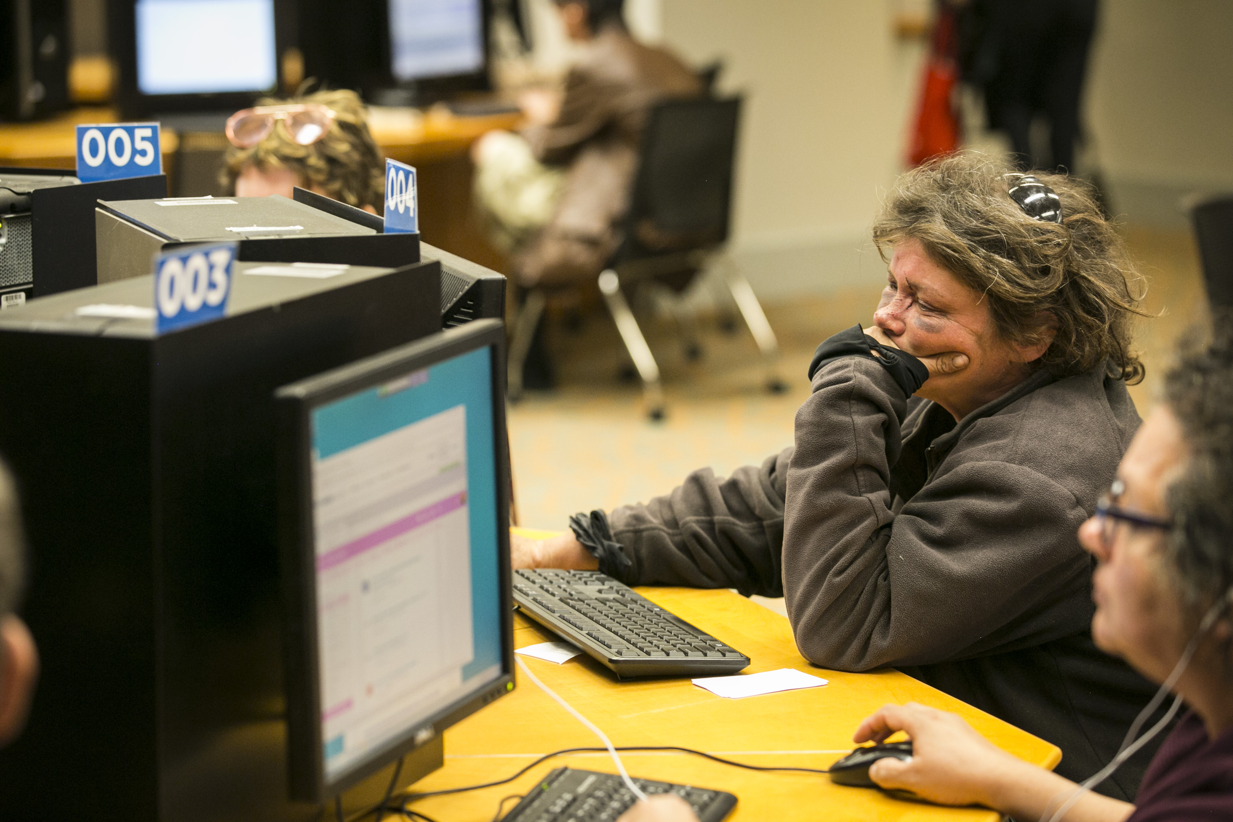 <p>Linda Campbelo of Denver uses a computerat the Denver Central Library to play a game on Thursday, June 25, 2017. Others nearby were watching movies, reading emails and browsing the web.</p>