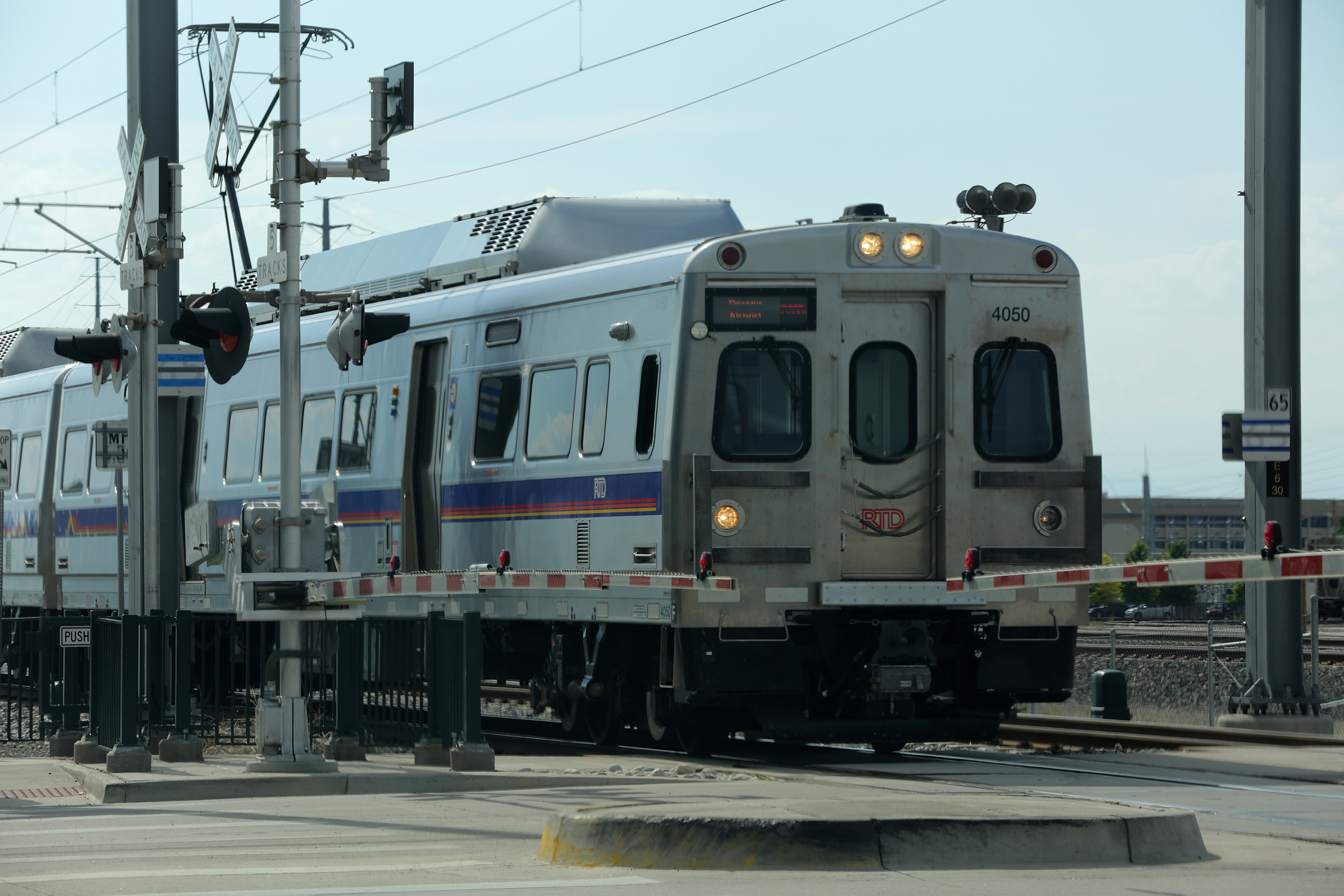 <p>An RTD commuter rail A Train near the Havana Street crossing on the way to Denver International Airport, July 17, 2018.</p>