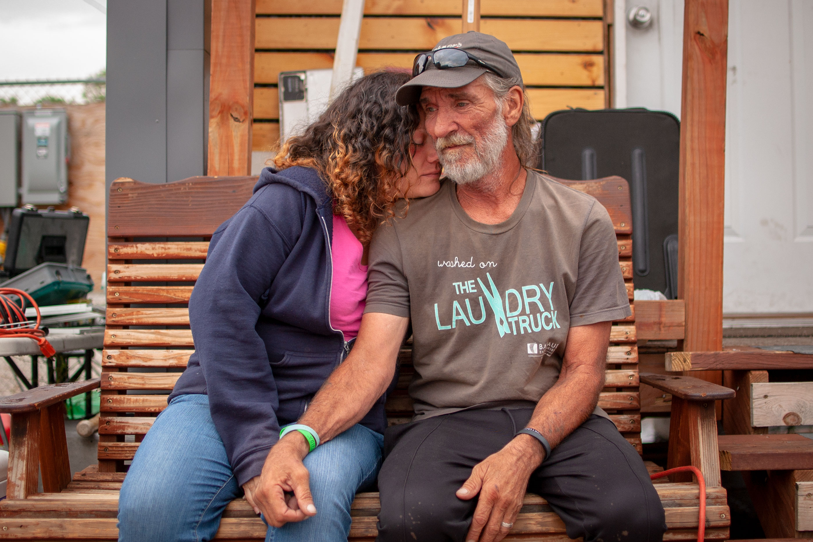 <p>Ray and Amanda Lyall outside their home at theBeloved Community Village in Denver, Colo.</p>
