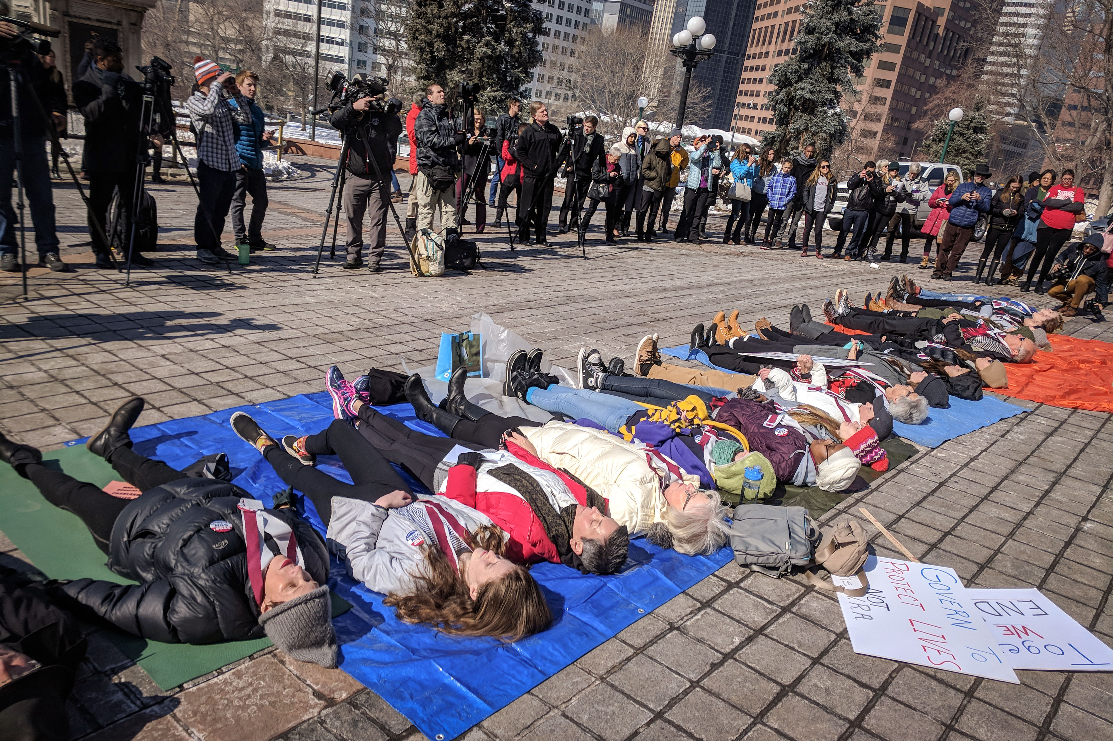 <p>Seventeen protesters lie in the plaza during a anti-gun violence demonstration in front the Colorado Capitol, Feb. 21, 2018.</p>