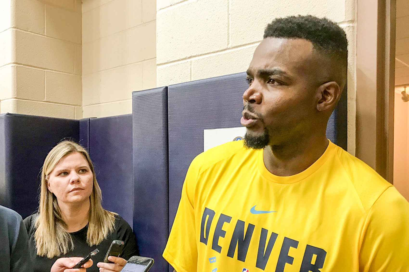 <p>Free agent Denver Nugget power forward Paul Millsap taking questions from reporters. The Denver Post's Gina Mizellis in the background.</p>