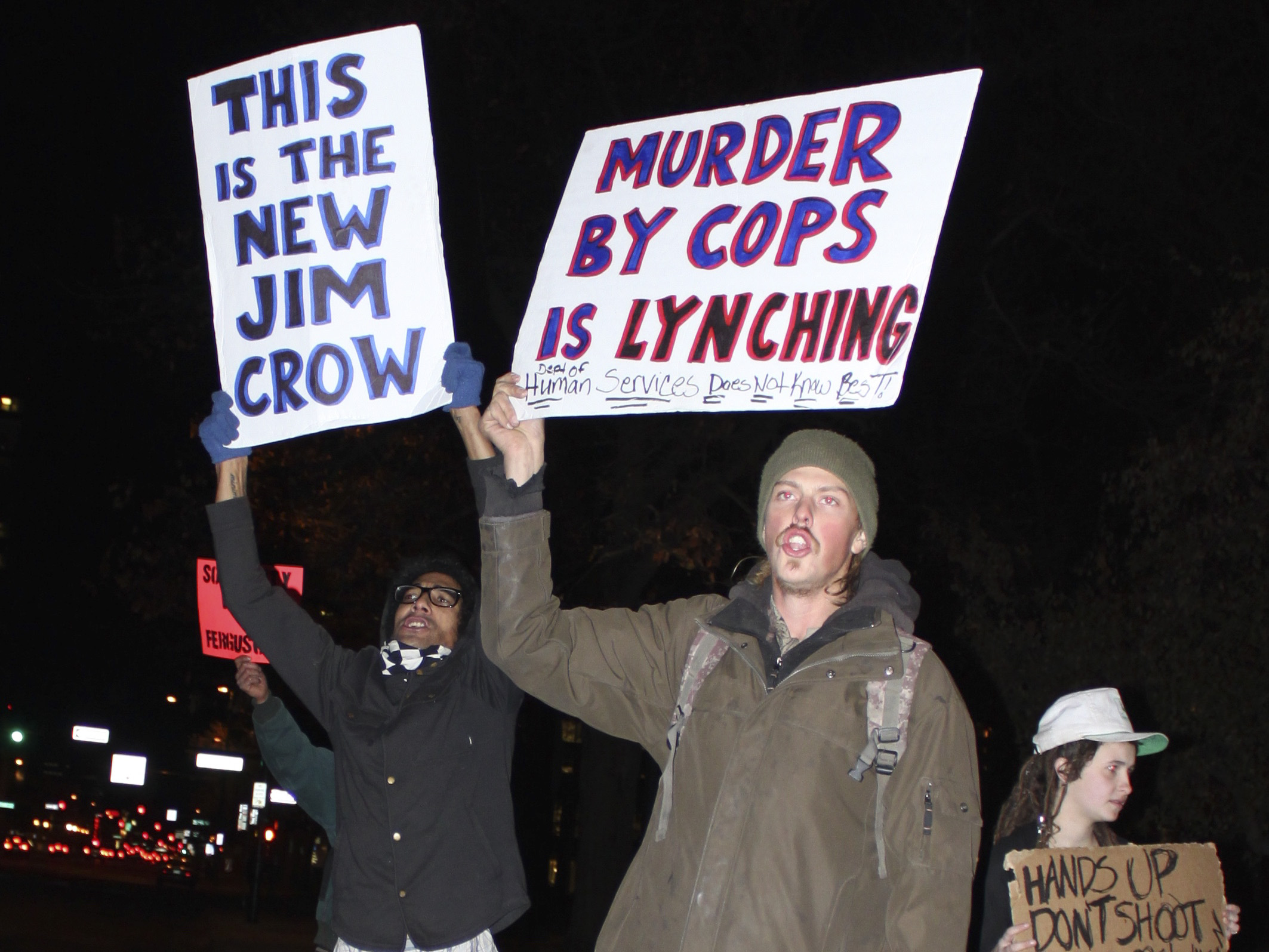 <p>About 100 people in Denver protested on Monday, Nov. 24, 2014, a Missouri grand jury's decision not to indict a white police officer who killed an unarmed black teen.</p>