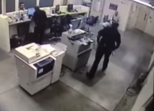 "<p> In this screenshot, <span style=""line-height: 1.66667em;"">Deputy Thomas Ford walks over to inmate Kyle Askins before striking him in the face.</span></p>"