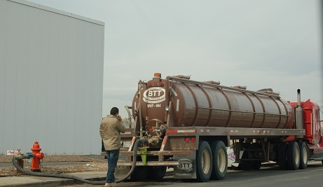 <p>A trucker fills up with water in the city of Greeley, Colo. The water is destined for drilling fields in Weld County</p>