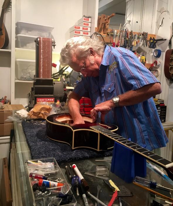<p>Kent Viles assembles a dobrato in his Gunnison guitar shop.</p>