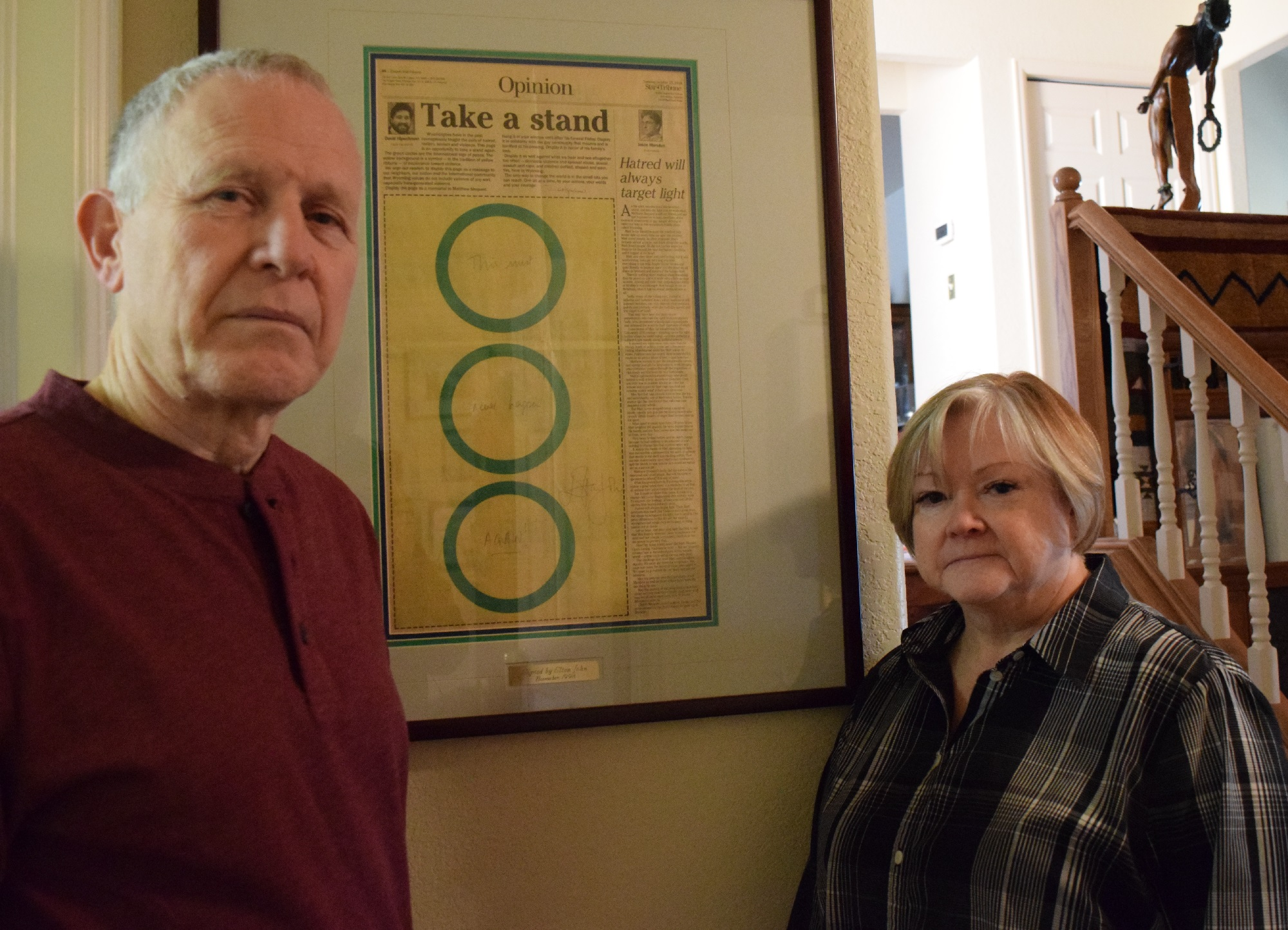 <p>Dennis and Judy Shepard stand in front of the newspaper story that ran after their gay son, Matthew was killed in October of 1998. The paper, signed by Elton John, hangs in their home in Casper, Wyo. on Jan. 8, 2019.</p>