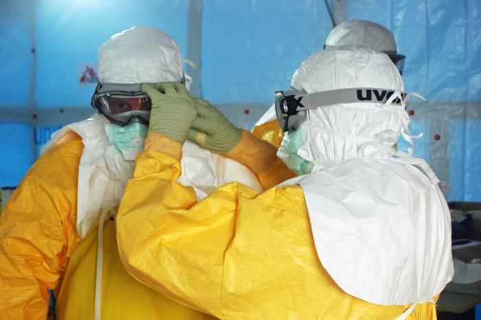 <p>Doctors in Monrovia, Liberia don protective gear prior to entering an Ebola treatment unit.</p>