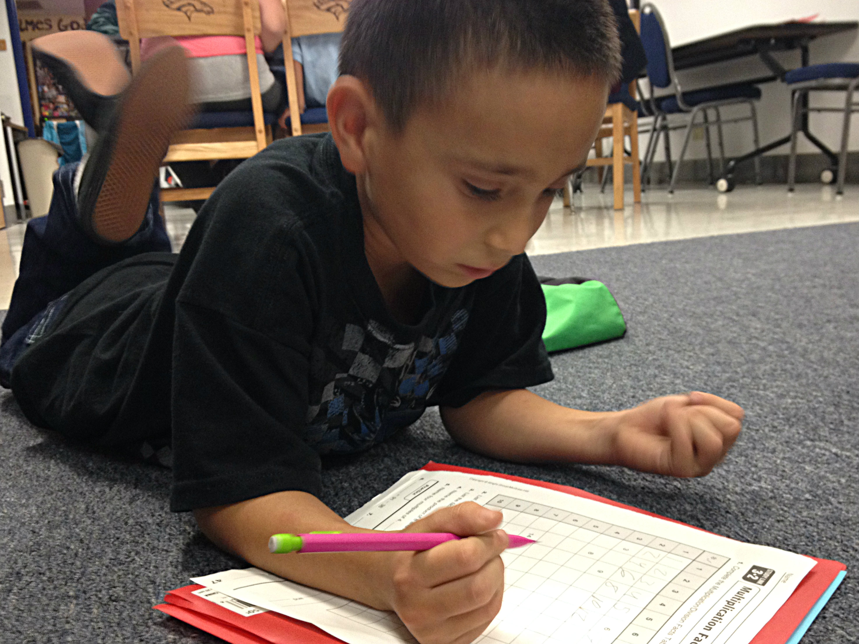 <p>James Rodriguez, 9, practices math homework in the Bronco room at The Crossing where he lives.</p>