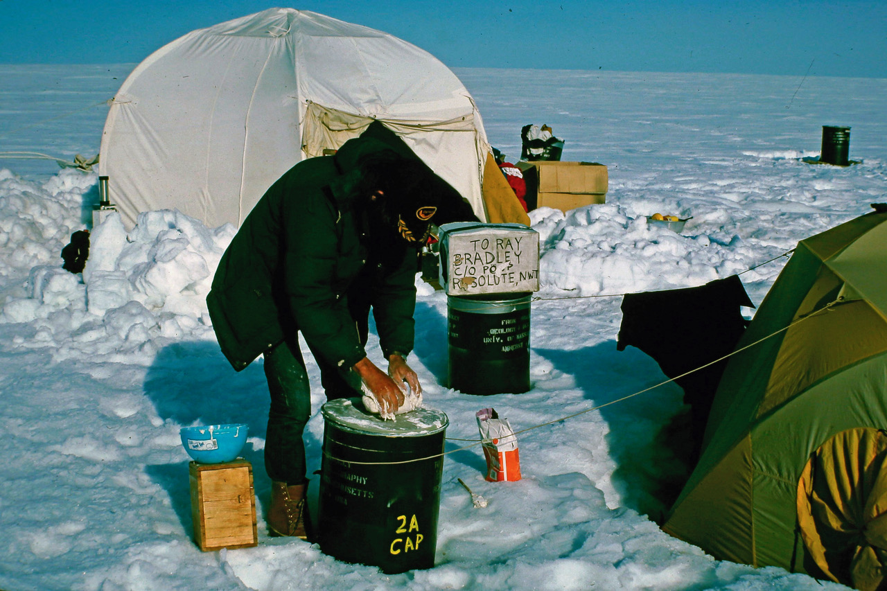 <p>A photo of Mark Serrezemaking bread by hand on Ellesmere Island in Northern Canada within theArctic Circlein 1982.</p>