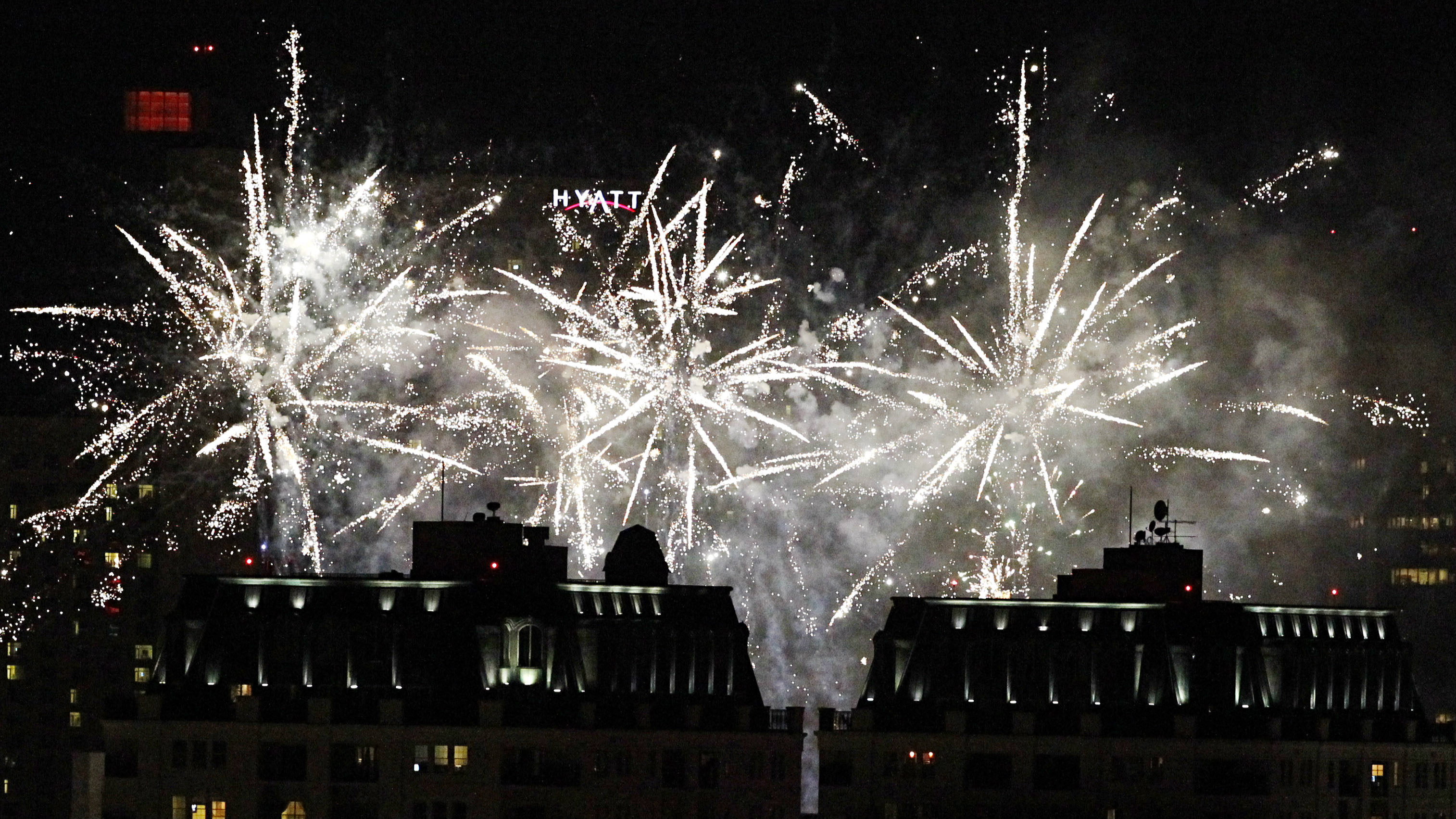 Fireworks explode over the skyline of downtown Denver during the Independence Eve at the City and County Building at Civic Center Park show in July 2012.