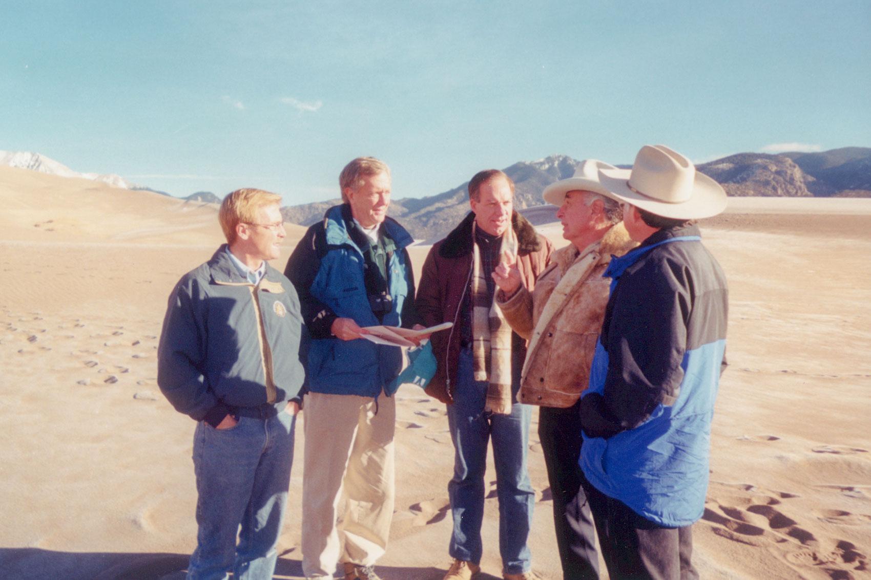 <p>December 18, 1999 marked the Summit in the Sand meeting at Great Sand Dunes National Park. From left to right: Rep Scott McInnis, Interior SecretaryBruce Babbitt, Sen. Wayne Allard, Sen.Ben Nighthorse Campbell andColorado Attorney General Ken Salazar.</p>