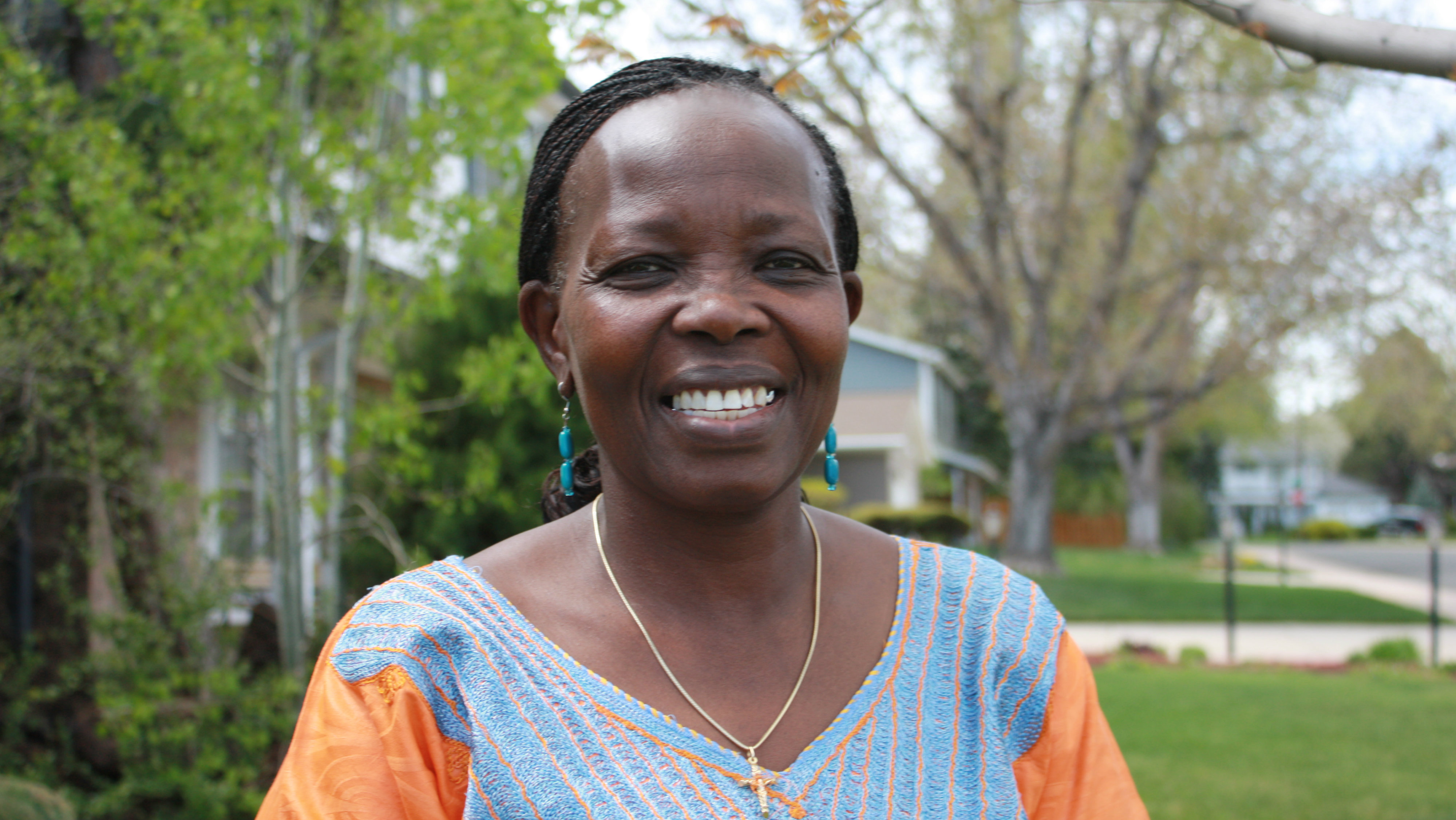 <p>Helen Achol Abyei outside her Denver home.</p>