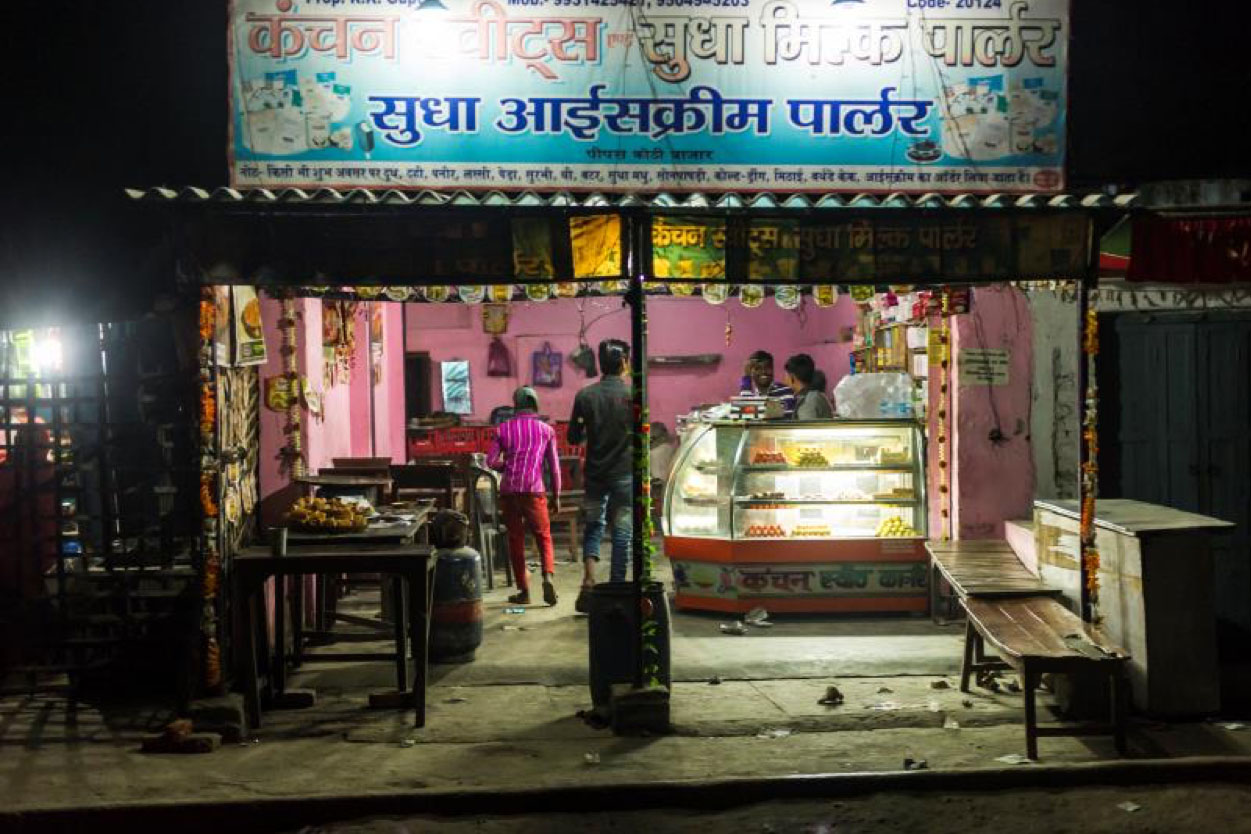 <p>Electric light allows a Husk Power Systems customer in the Indian state of Bihar to to keep his shop open until11 p.m., which increasesbusiness.</p>
