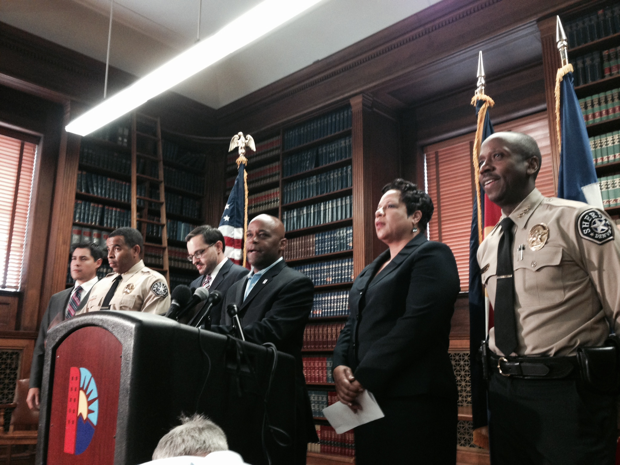 "<p>Flanked by city officials, Denver Mayor Michael B. Hancock, center, announces the resignation of Sheriff <span style=""line-height: 1.66667em;"">Gary Wilson, at far right, on Monday, July 21, 2014.</span></p>"