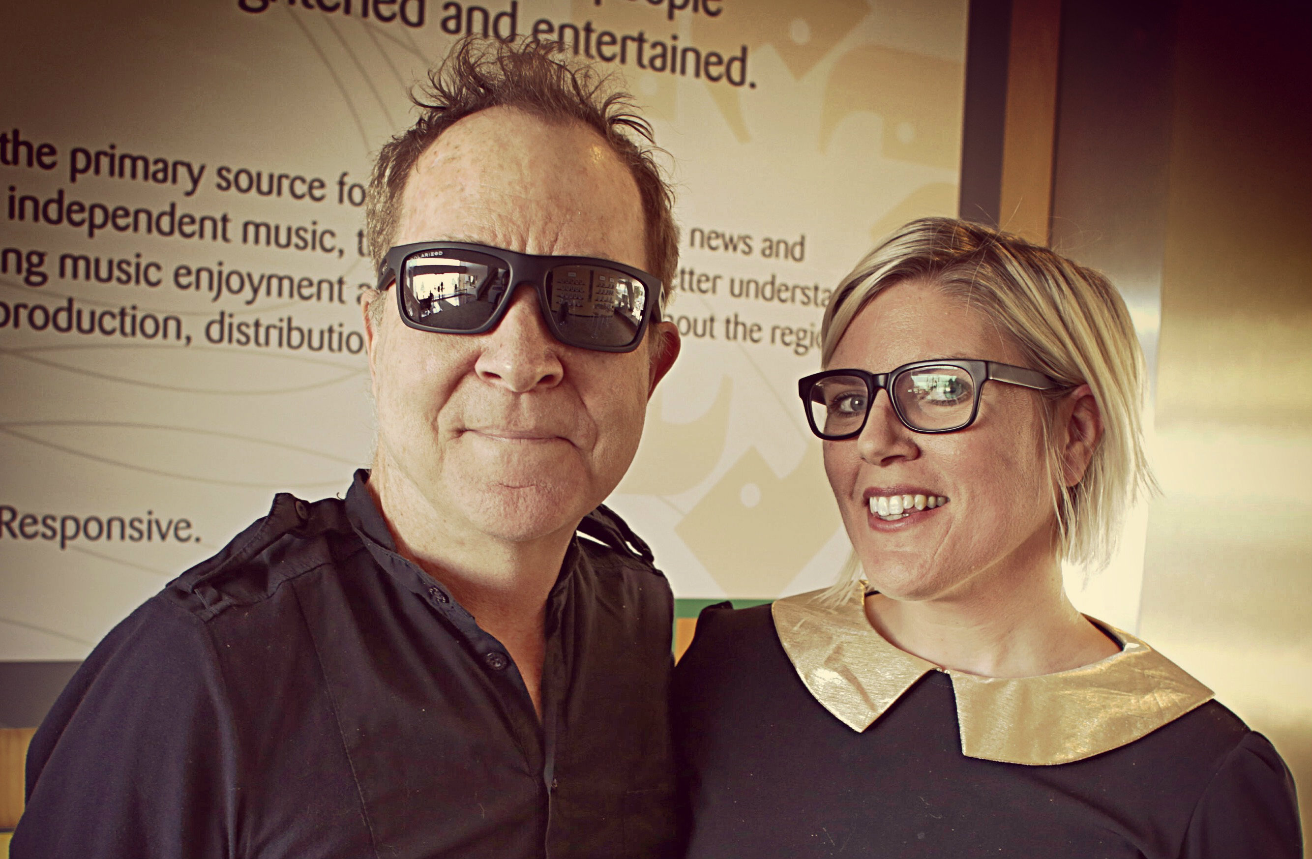 <p>Fred Schneider of The B-52's and Alisha Sweeney</p>