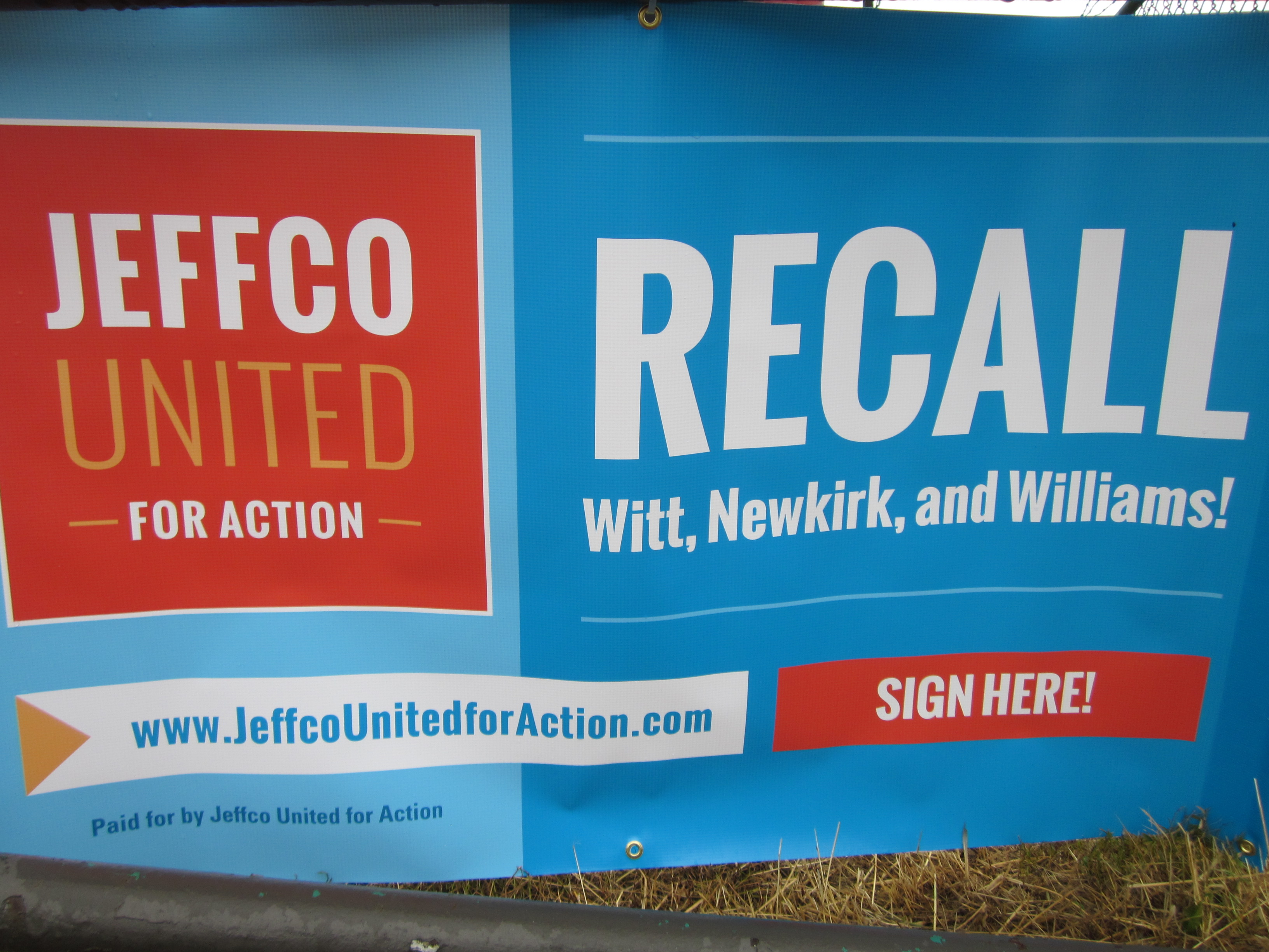 <p>A banner from JeffCo United For Action, the group trying to recall three school board members.</p>