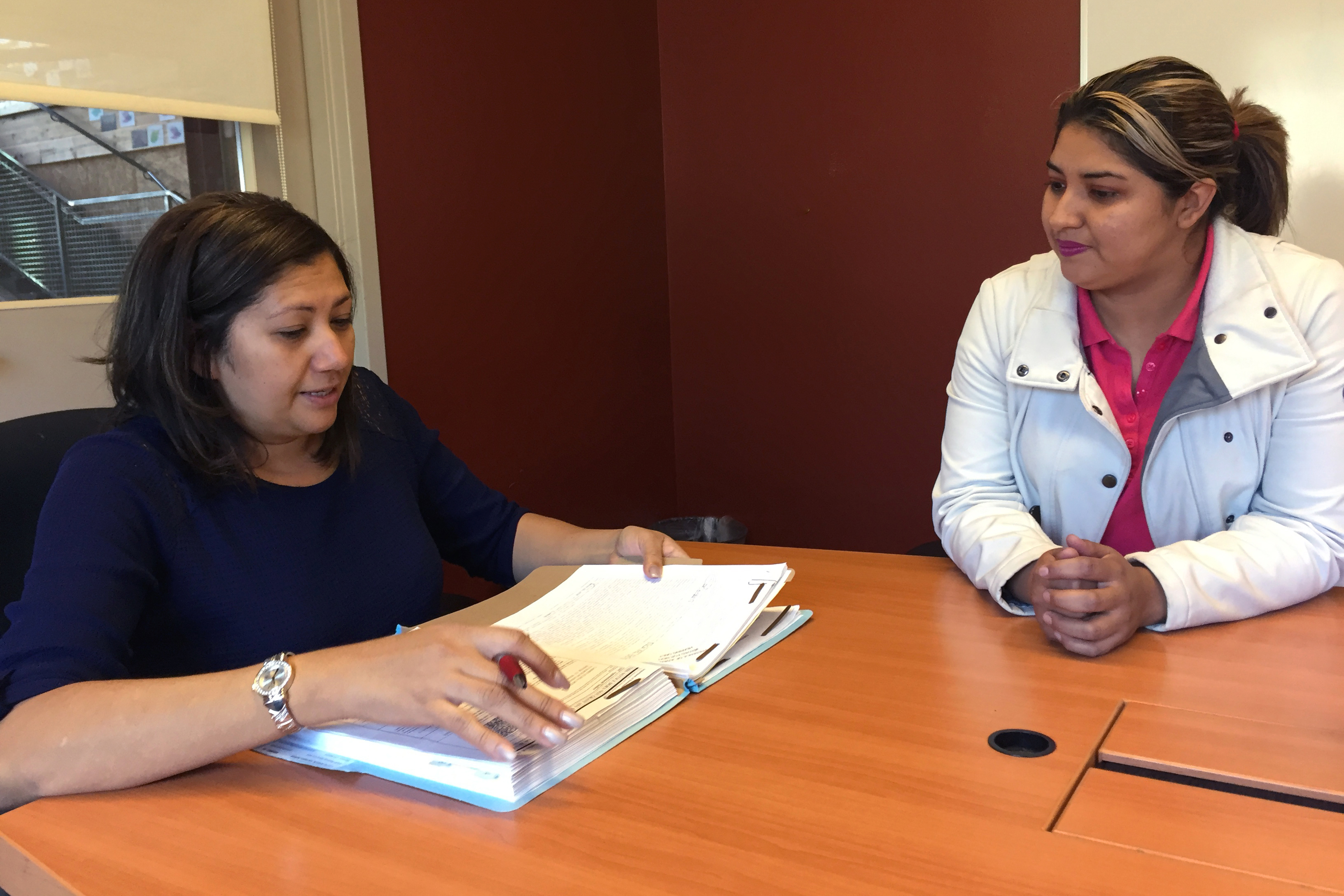 <p>Carmen Ortiz (right) discusses her asylum case with her lawyer, Sulma Mendoza (left), at the Justice and Mercy Legal Aid Center in Denver on Nov. 5, 2018. The center received a $95,500 grant from the Denver Immigrant Legal Services Fund to represent people in deportation proceedings. The goal of the fund is to expand the pro bono capacity in Denver to handle everything from removal cases to naturalization paperwork.</p>