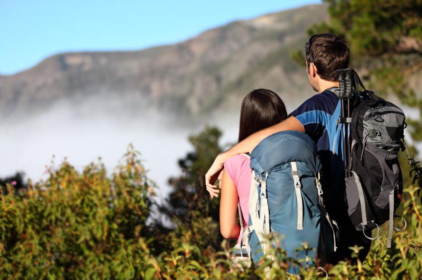 <p>A couple takes in mountain views.</p>
