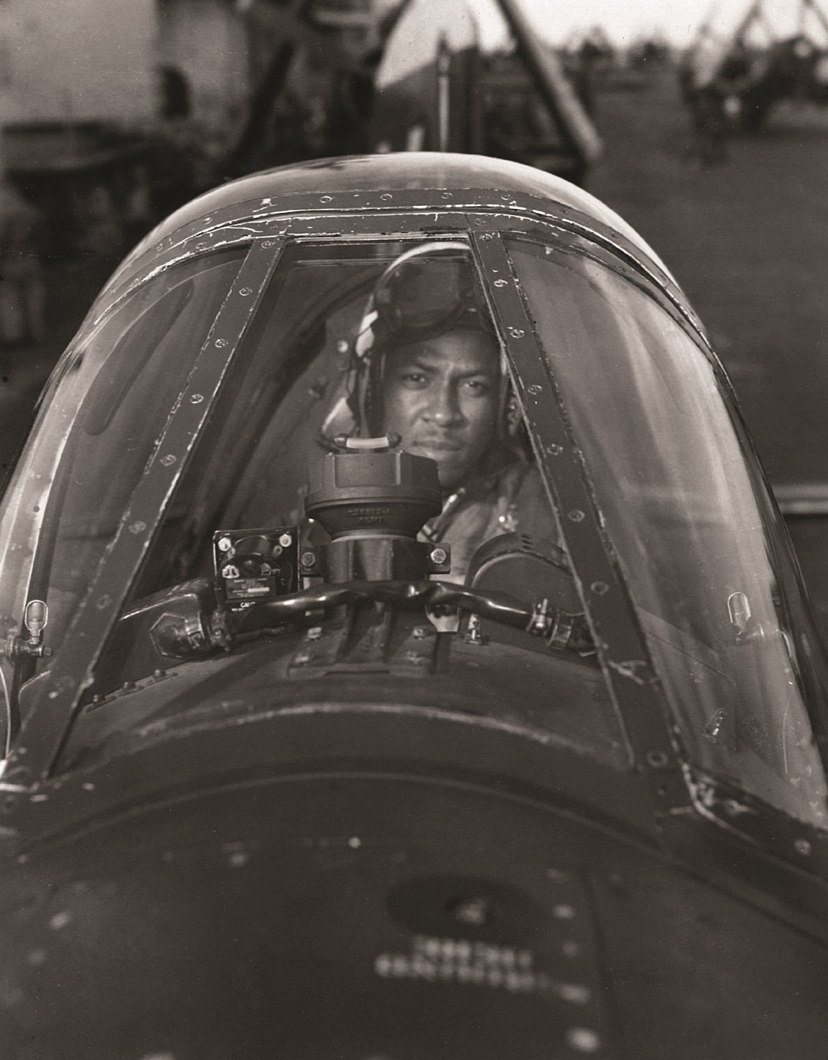 <p>Navy Ensign Jesse Brown as seen through thewindscreen of his Corsair in late November of 1950.</p>